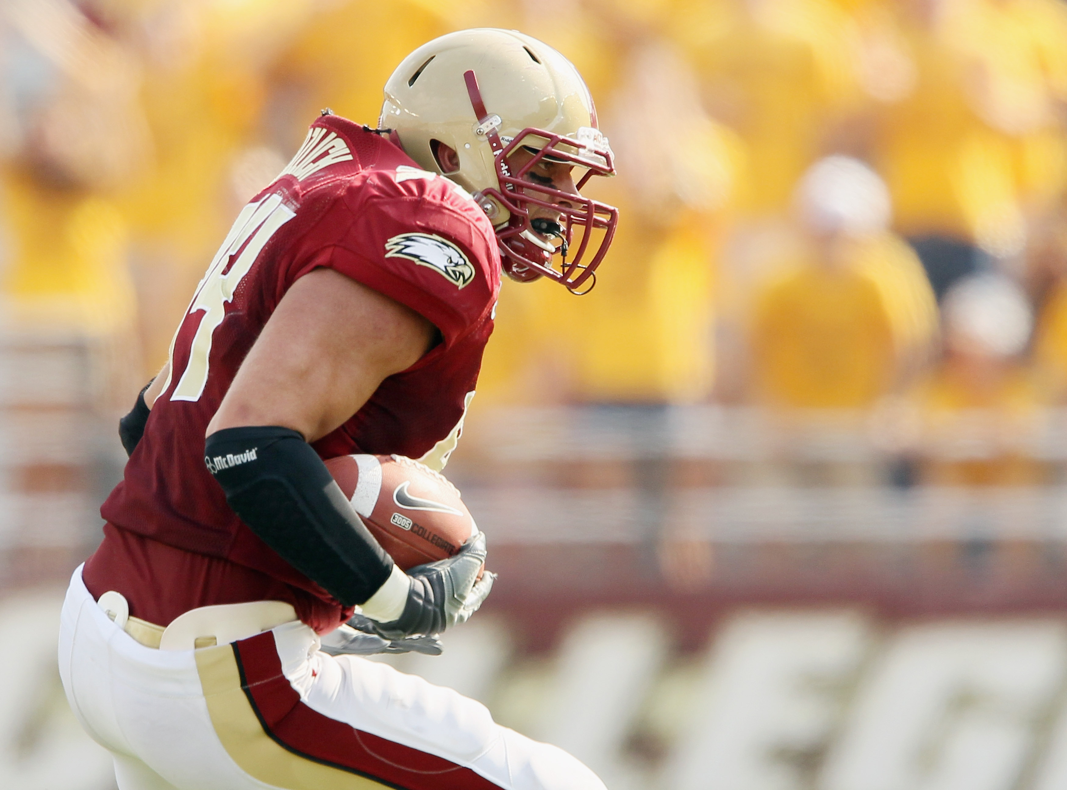 CHESTNUT HILL, MA - SEPTEMBER 25:  Mark Herzlich #94 of the Boston College Eagles carries the ball after he intercepted a pass from Tyrod Taylor of the Virginia Tech Hokies on September 25, 2010 at Alumni Stadium in Chestnut Hill, Massachusetts. Virginia