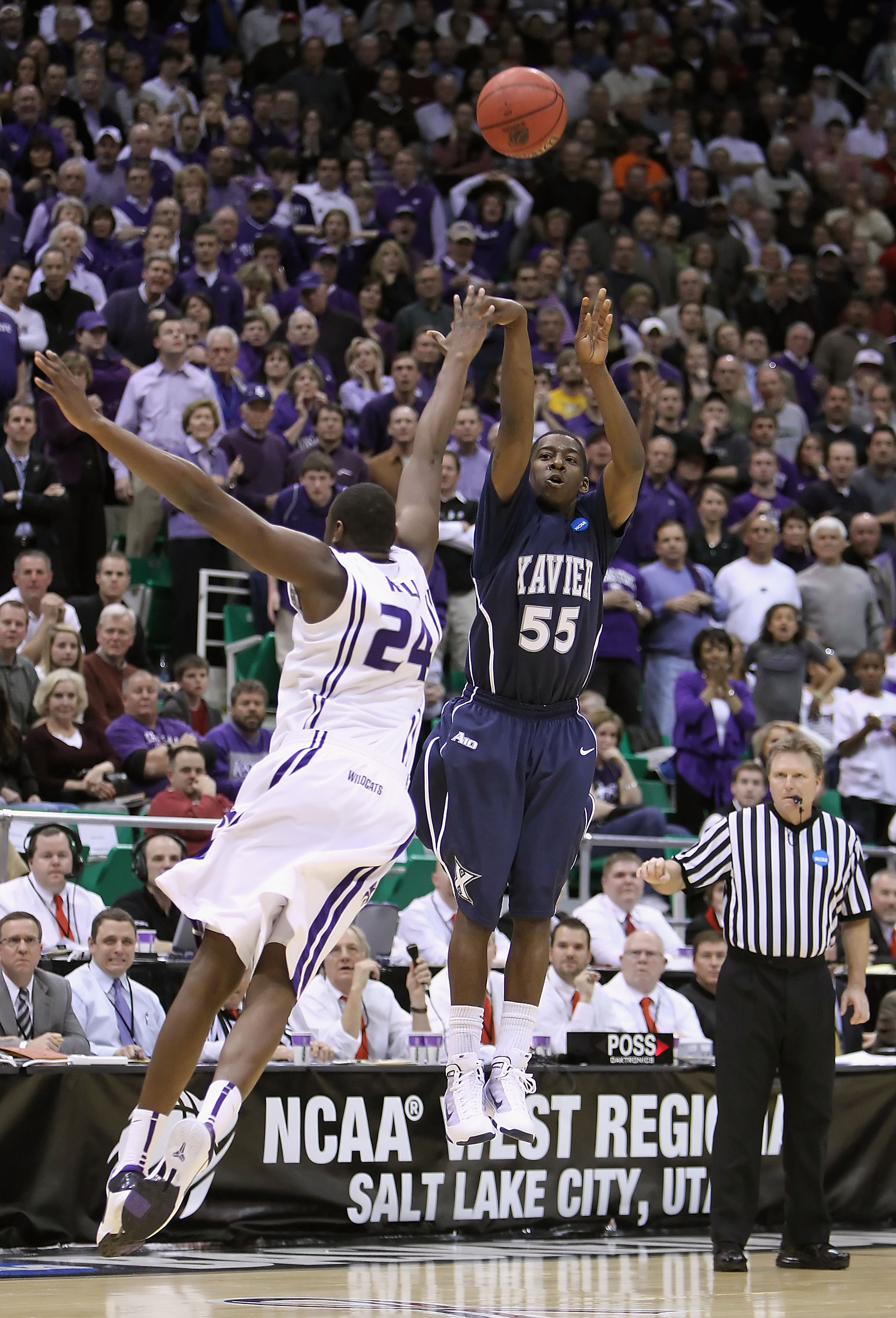 SALT LAKE CITY - MARCH 25:  Jordan Crawford #55 of the Xavier Musketeers hits a three point shot over Curtis Kelly #24 of the Kansas State Wildcats to force double overtime during the west regional semifinal of the 2010 NCAA men's basketball tournament at