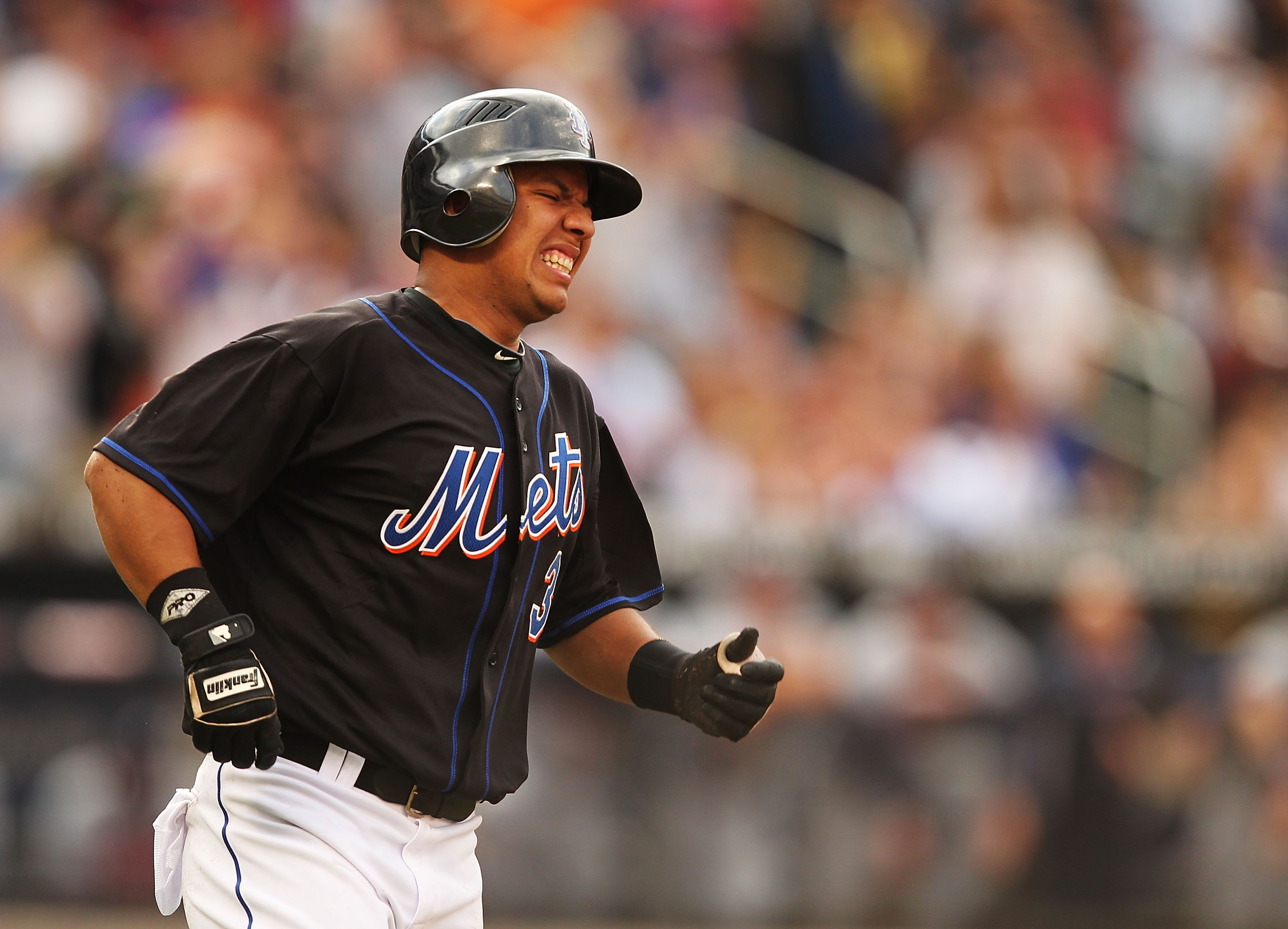 NEW YORK - SEPTEMBER 18:  Luis Hernandez #3 of the New York Mets winces in pain while rounding the bases after hitting a home run against  the Atlanta Braves in the fifth inning during their game on September 18, 2010 at Citi Field in the Flushing neighbo