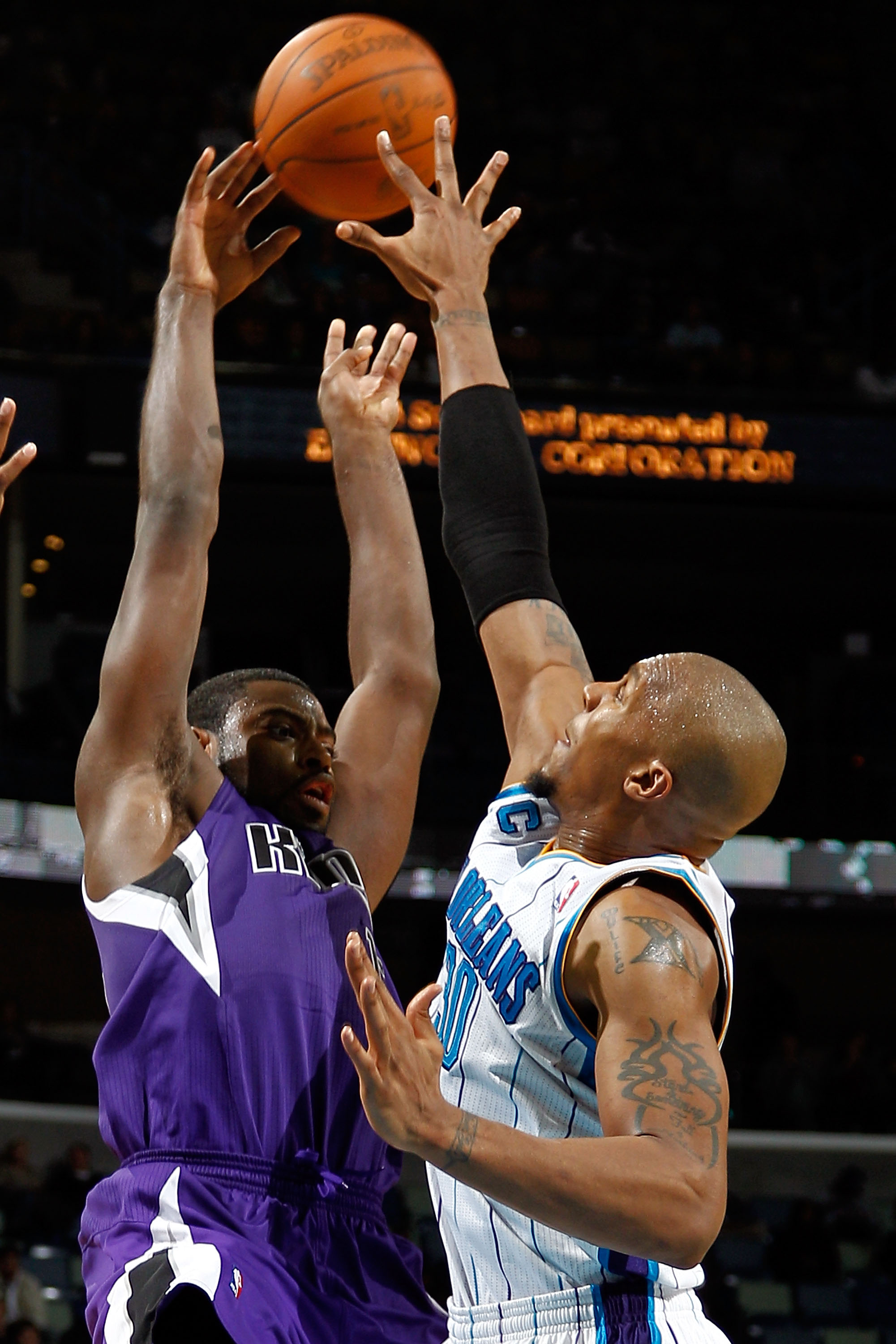 NEW ORLEANS, LA - DECEMBER 15:  Tyreke Evans #13 of the Sacramento Kings passes the ball over David West #30 of the New Orleans Hornets  at the New Orleans Arena on December 15, 2010 in New Orleans, Louisiana.  NOTE TO USER: User expressly acknowledges an