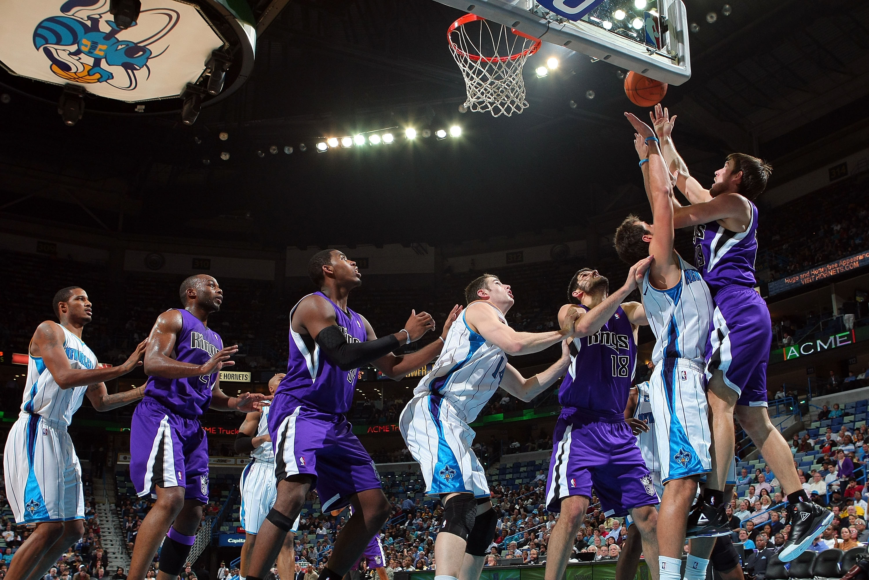 NEW ORLEANS, LA - DECEMBER 15:  Beno Udrih #19 of the Sacramento Kings shoots the ball over Marco Belinelli #8 of the New Orleans Hornets  at the New Orleans Arena on December 15, 2010 in New Orleans, Louisiana.  The Hornets defeated the Kings 94-91.  NOT