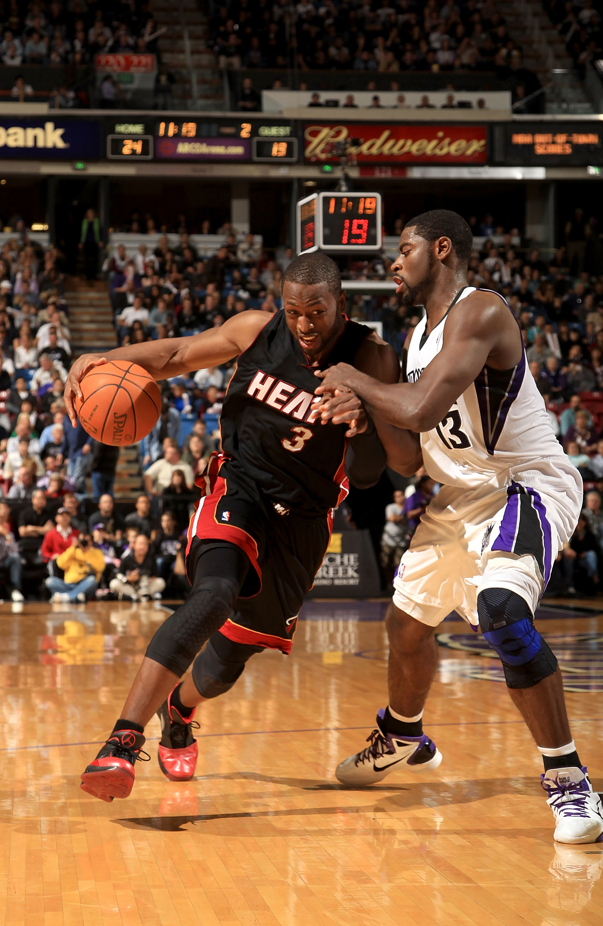 SACRAMENTO, CA - DECEMBER 11: Dwyane Wade #3 of the Miami Heat drives on Tyreke Evans #13 of the Sacramento Kings at ARCO Arena on December 11, 2010 in Sacramento, California. NOTE TO USER: User expressly acknowledges and agrees that, by downloading and o