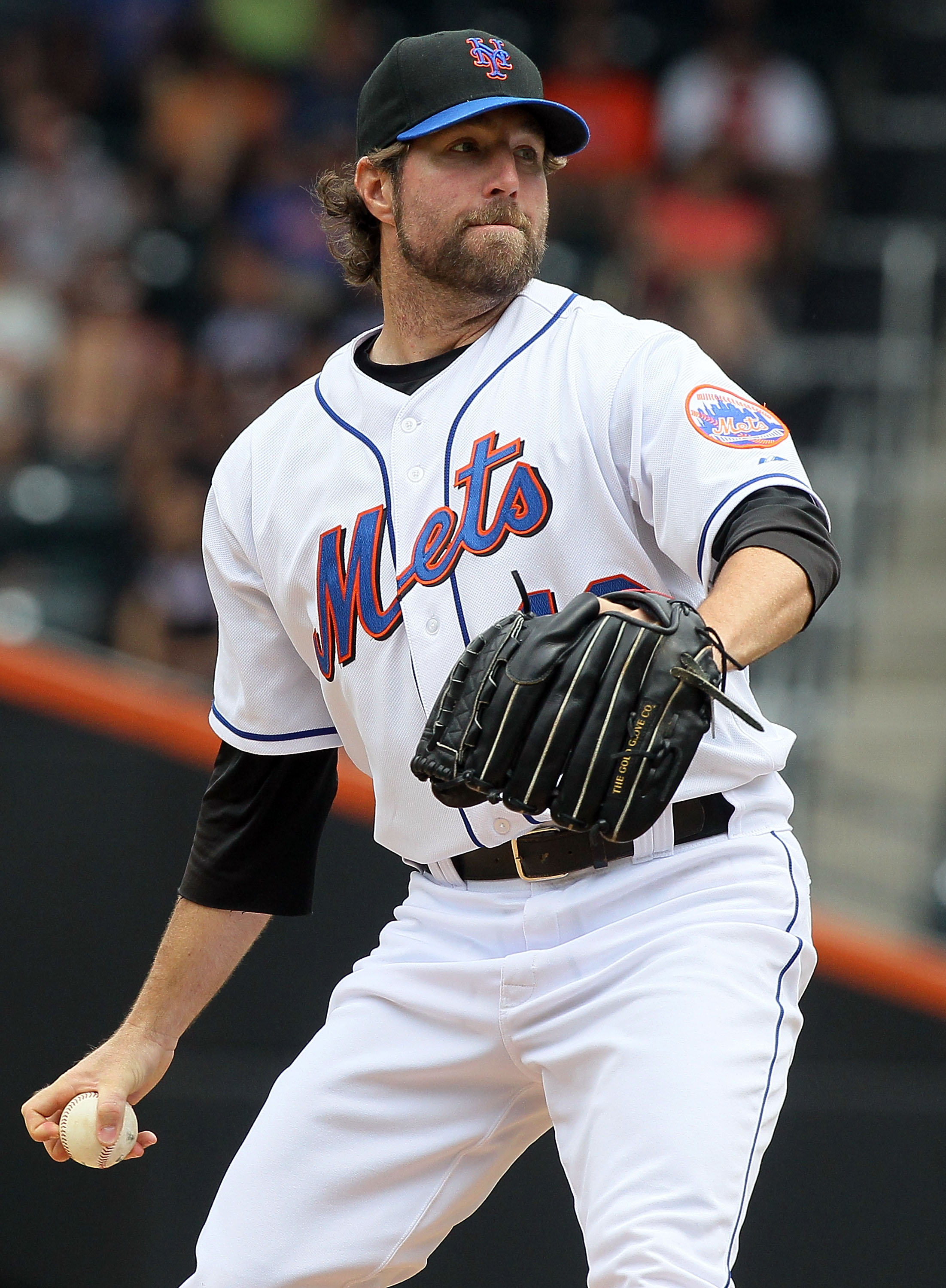 NEW YORK - JULY 29:  R.A. Dickey #43 of the New York Mets delivers a pitch against the St. Louis Cardinals on July 29, 2010 at Citi Field in the Flushing neighborhood of the Queens borough of New York City.  (Photo by Jim McIsaac/Getty Images)