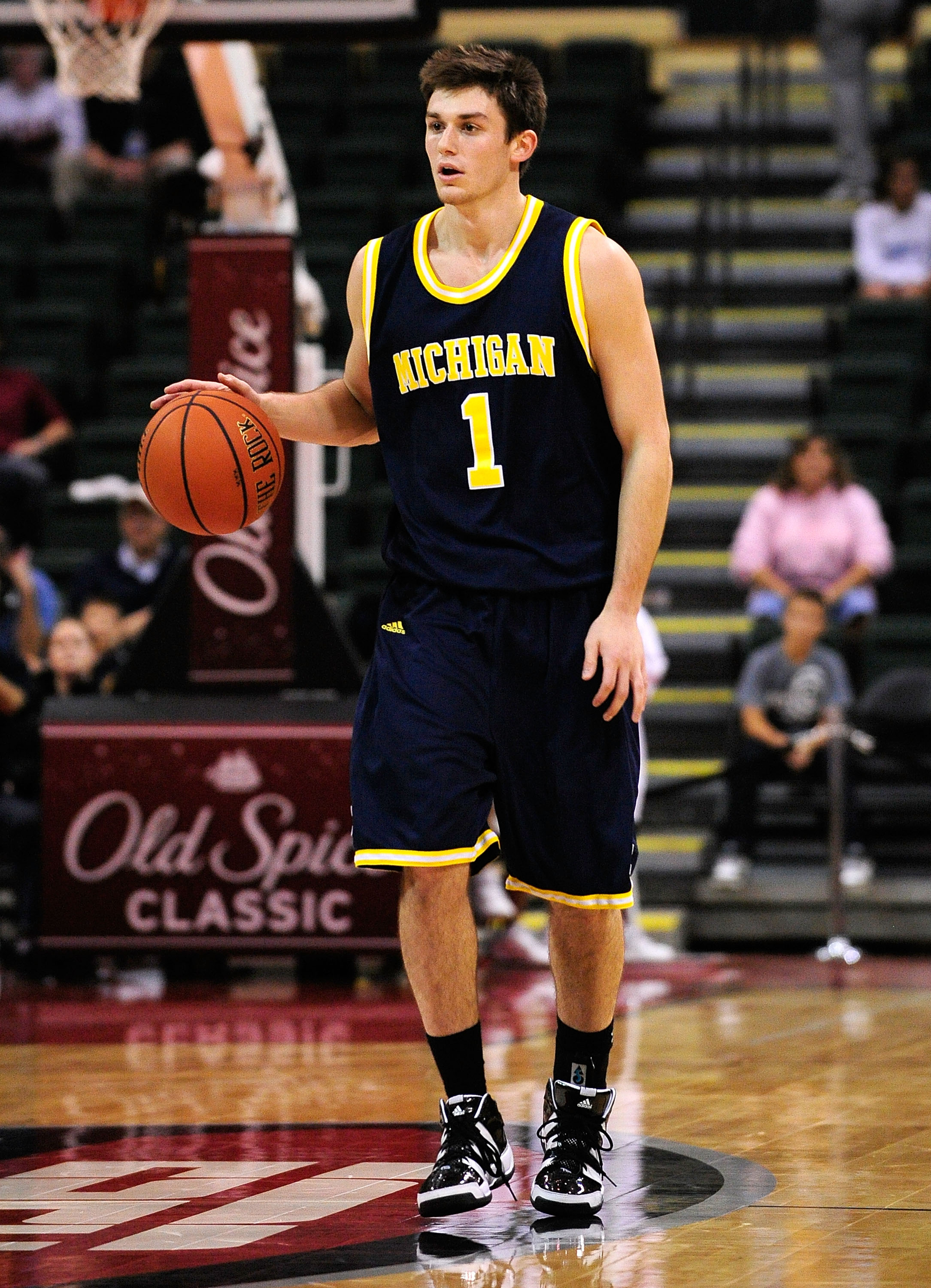 ORLANDO, FL - NOVEMBER 27:  Stu Douglas #1 of the Michigan Wolverines looks to pass against the Marquette Golden Eagles during the Old Spice Classic at Disney's Milk House on November 27, 2009 in Orlando, Florida. Marquette defeated Michigan 79-65.  (Phot