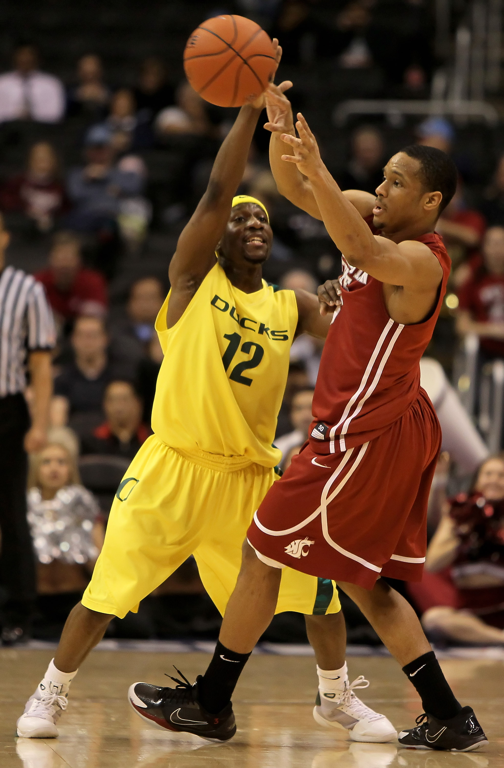 LOS ANGELES, CA - MARCH 10:  Reggie Moore #3 of the Washington State Cougars is defended by Tajuan Porter #12 of the Oregon Ducks in the second half during the first round of the Pac-10 Basketball Tournament at Staples Center on March 10, 2010 in Los Ange