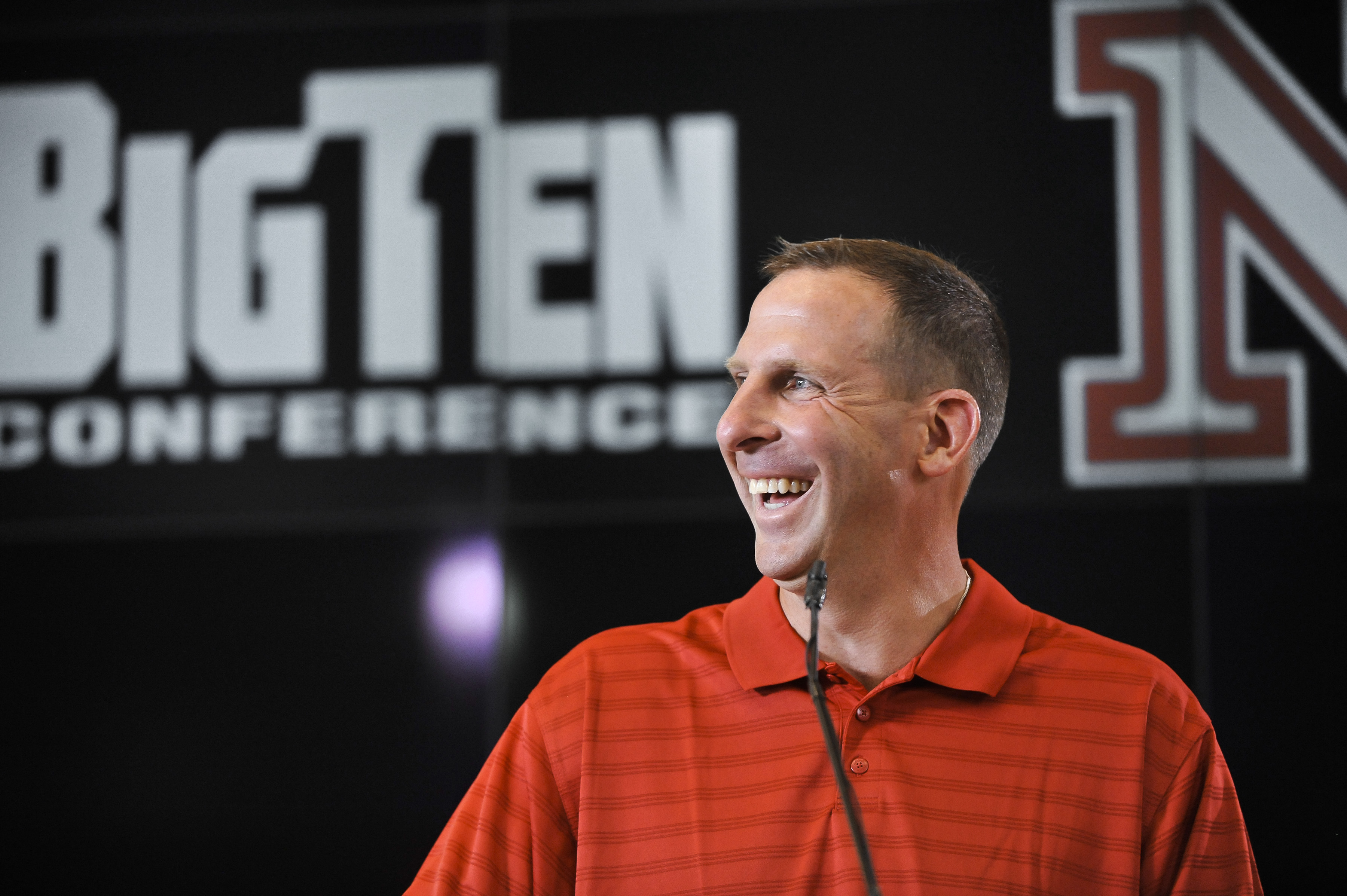LINCOLN, NE - JUNE 11:  University of Nebraska football coach Bo Pelini jokes with members of the media at a press conference announcing Nebraska accepting an invitation to join the Big Ten Conference June 11, 2010  in Lincoln, Nebraska.  The university w