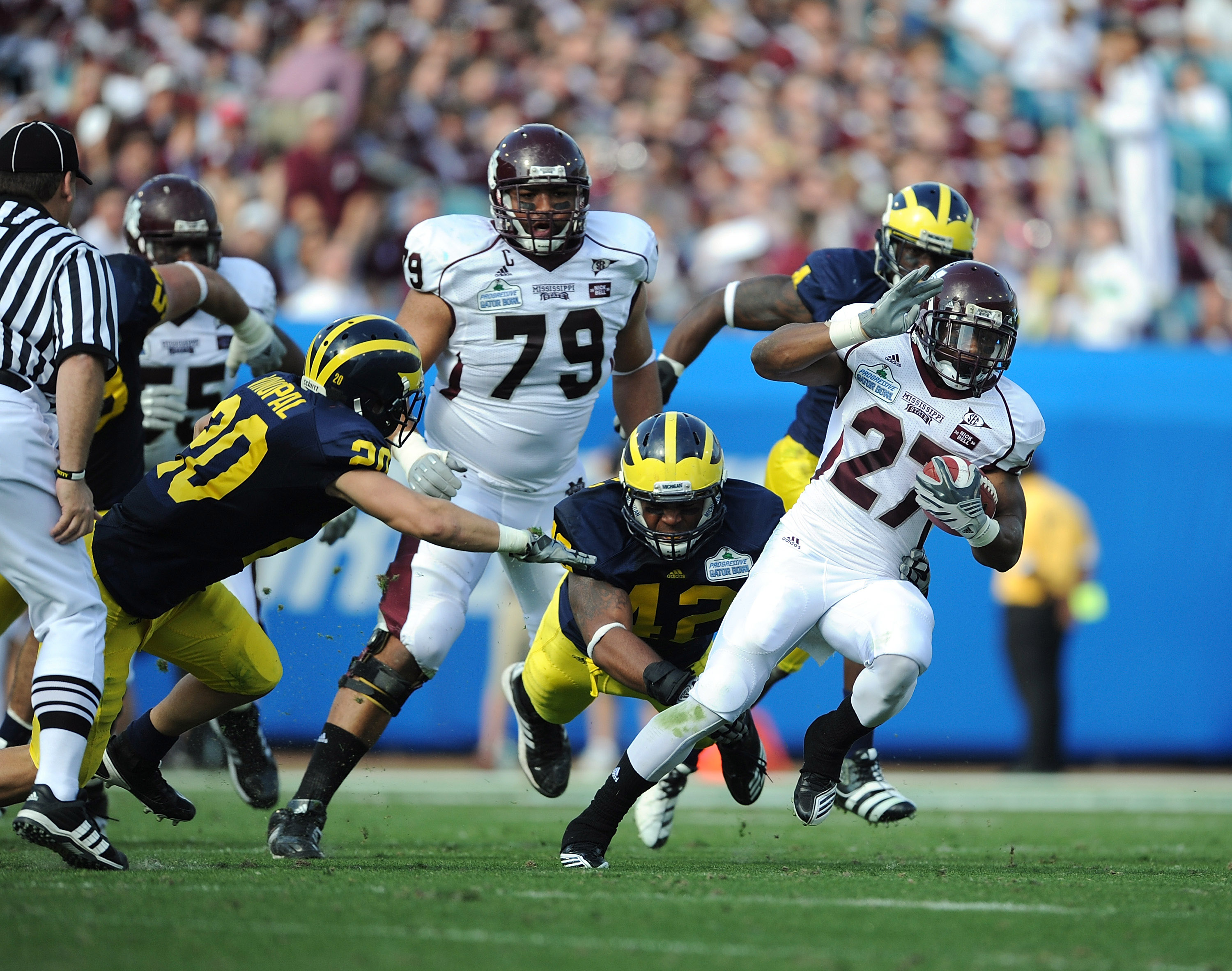 JACKSONVILLE, FL - JANUARY 01:  LaDarius Perkins # 27 of the Mississippi State Bulldogs rushes against the Michigan Wolverines during the Gator Bowl at EverBank Field on January 1, 2011 in Jacksonville, Florida  (Photo by Rick Dole/Getty Images)