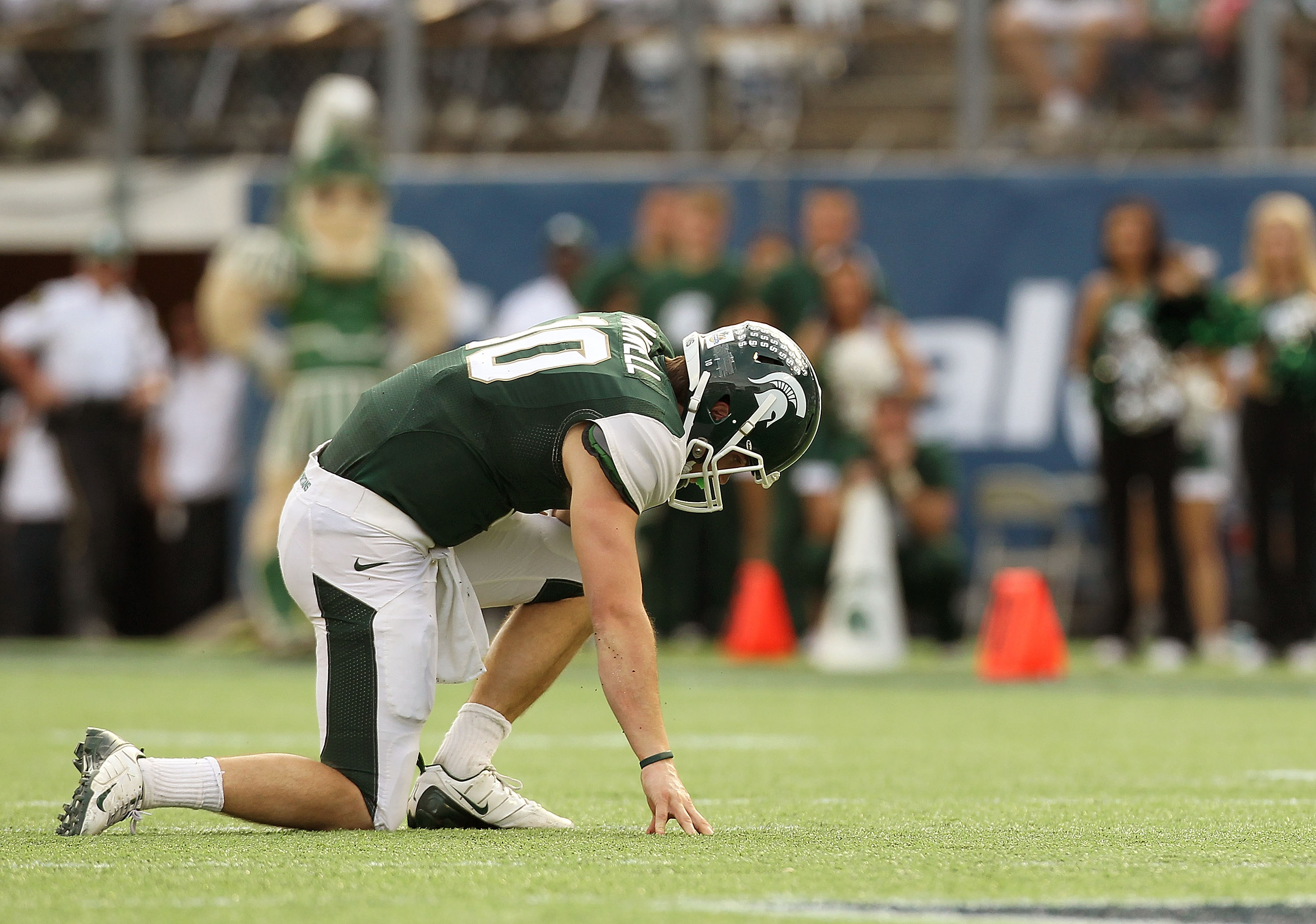 ORLANDO, FL - JANUARY 01:  Andrew Maxwell #10 of the Michigan State Spartans is shaken up on a play during the Capitol One Bowl against the Alabama Crimson Tide at the Florida Citrus Bowl on January 1, 2011 in Orlando, Florida.  (Photo by Mike Ehrmann/Get