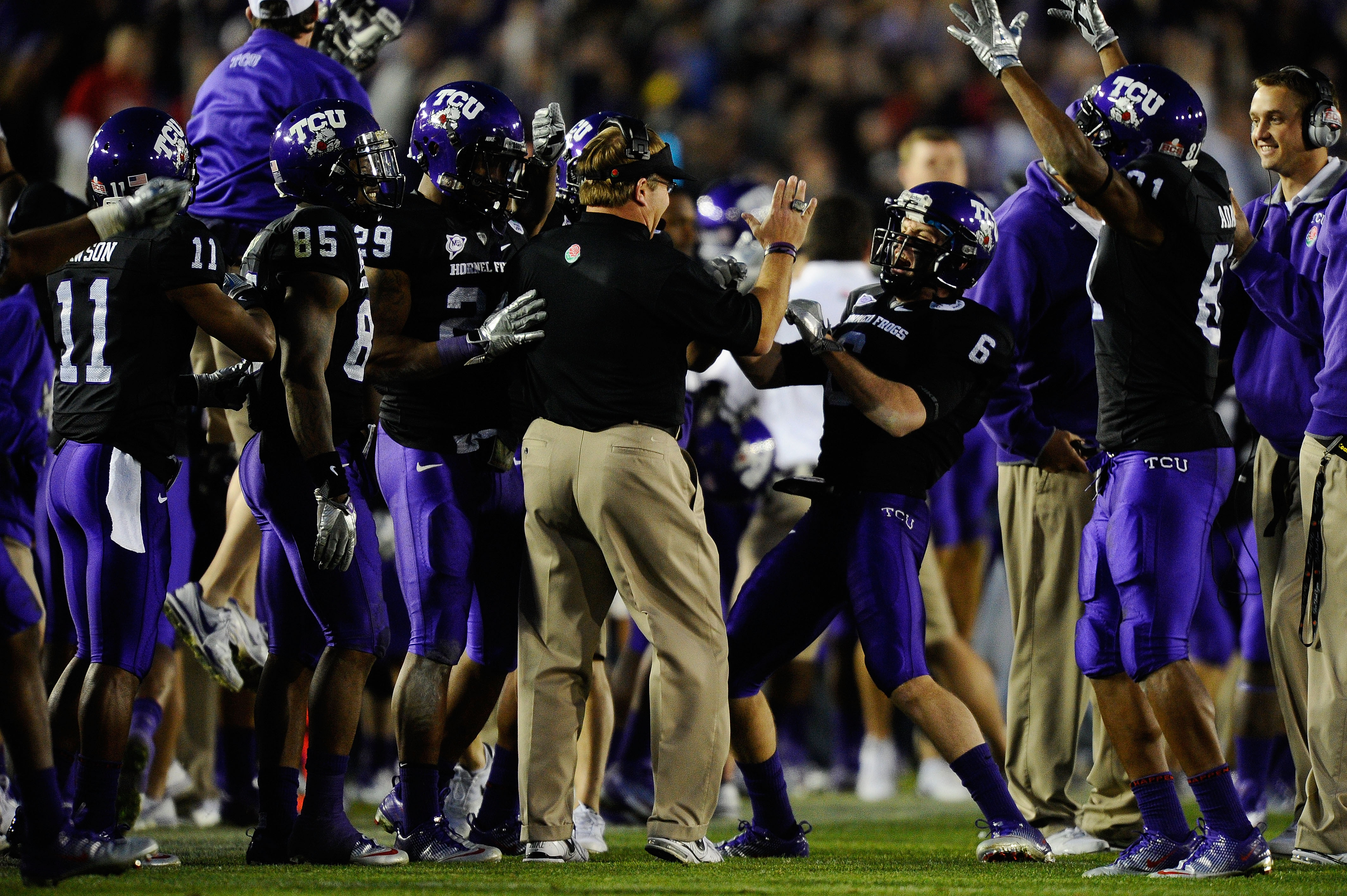 PASADENA, CA - JANUARY 01:  The TCU Horned Frogs celebrate after recovering an onside kick by the Wisconsin Badgers in the fourth quarter of the 97th Rose Bowl game on January 1, 2011 in Pasadena, California.  (Photo by Kevork Djansezian/Getty Images)