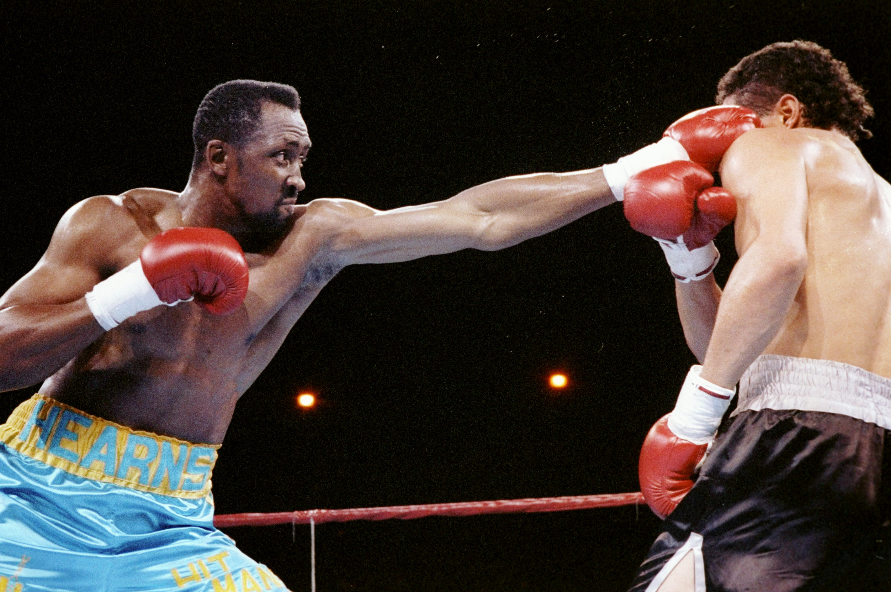 3 Jun 1991:  Thomas Hearns (left) lands a punch to the face of his opponent Virgil Hill. Mandatory Credit: Holly Stein  /Allsport