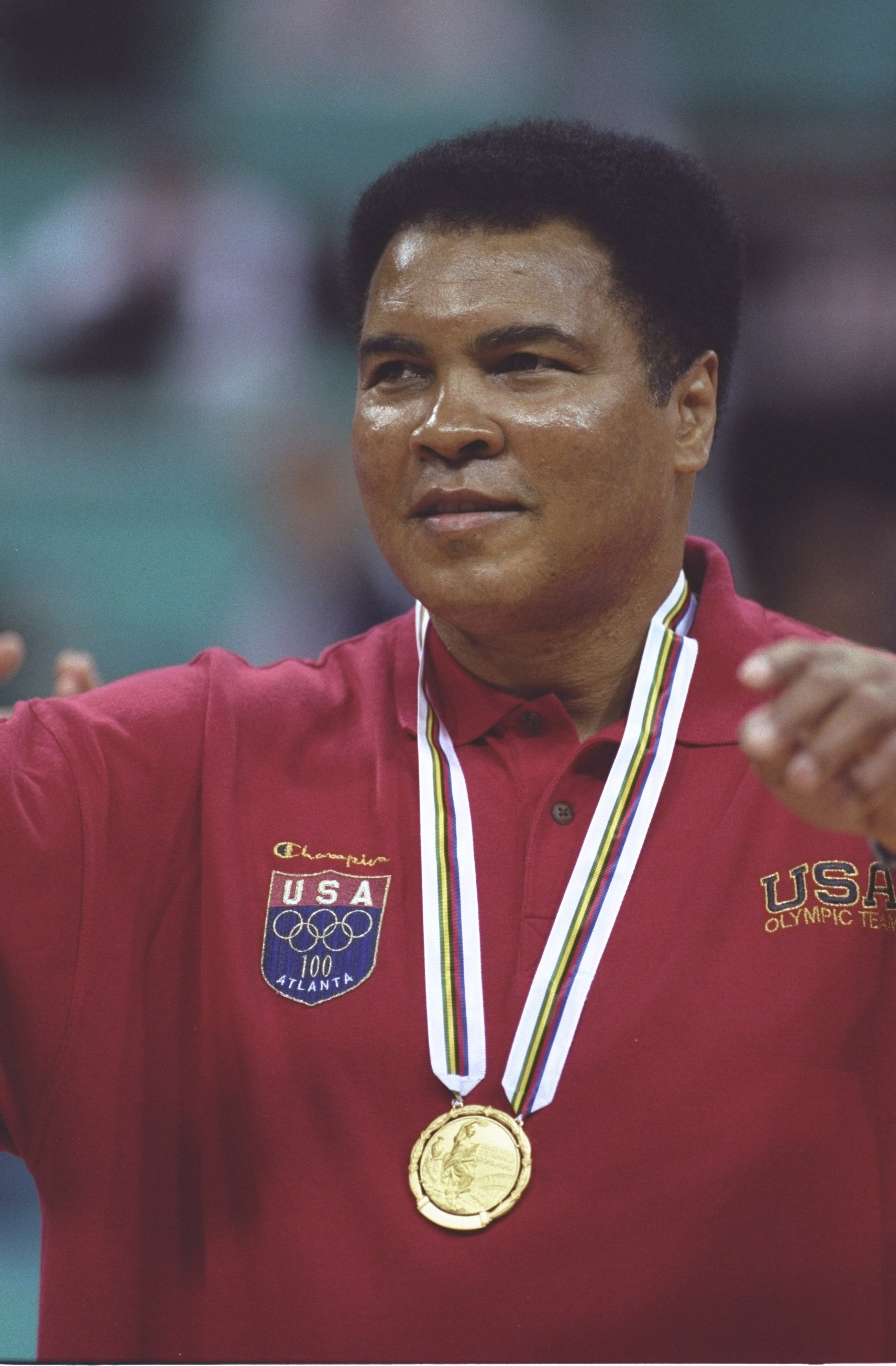 3 Aug 1996:  Muhammad Ali receives a replacement gold medal for one he lost many years ago during a halftime ceremony of the Yugoslavia v USA basketball game at the Georgia Dome at the 1996 Centennial Olympic Games in Atlanta, Georgia. Mandatory Credit: D