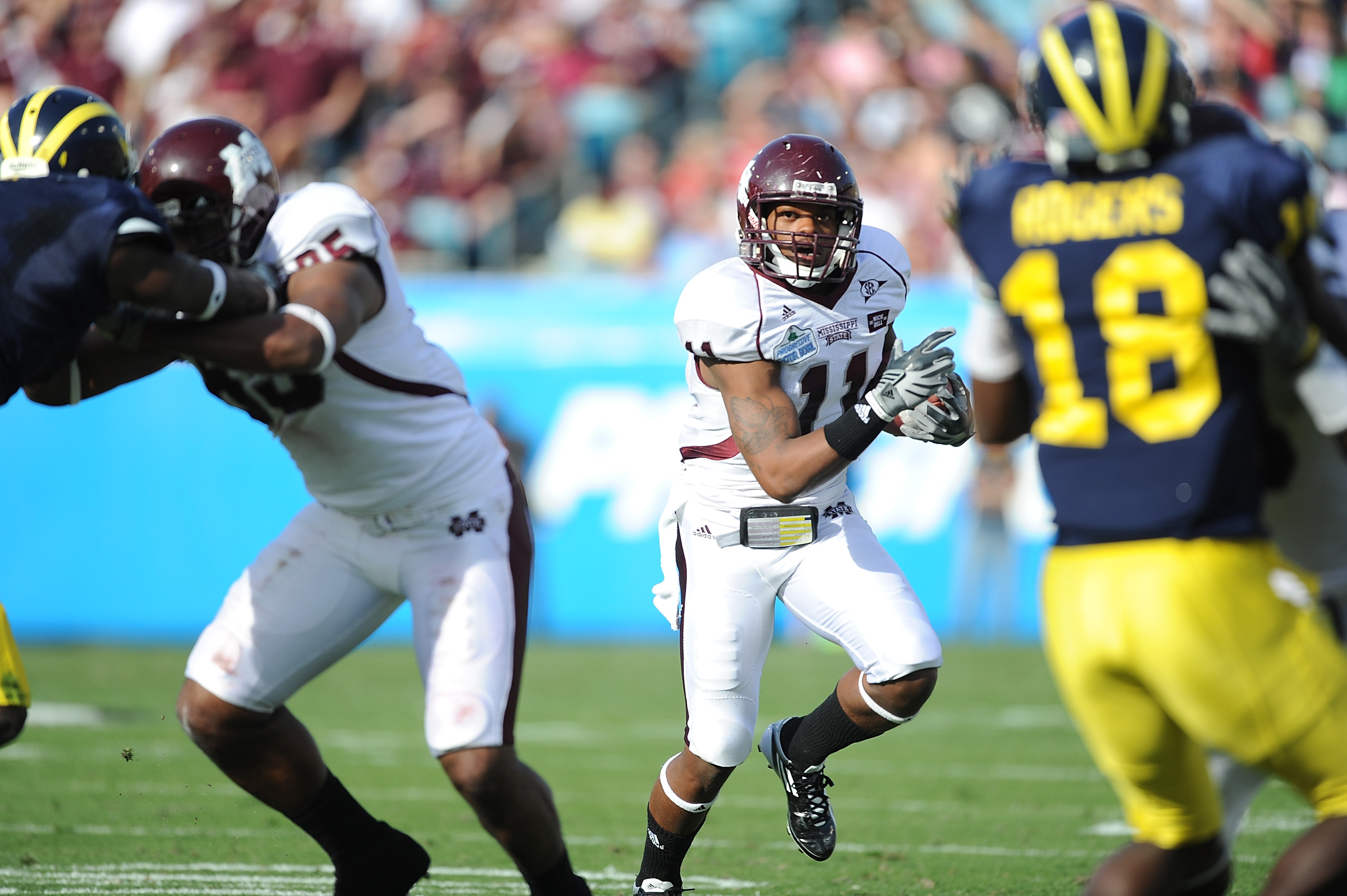 JACKSONVILLE, FL - JANUARY 01:  Ricco Sanders #11 of the Mississippi State Bulldogs rushes against the Michigan Wolverines during the Gator Bowl at EverBank Field on January 1, 2011 in Jacksonville, Florida  (Photo by Rick Dole/Getty Images)