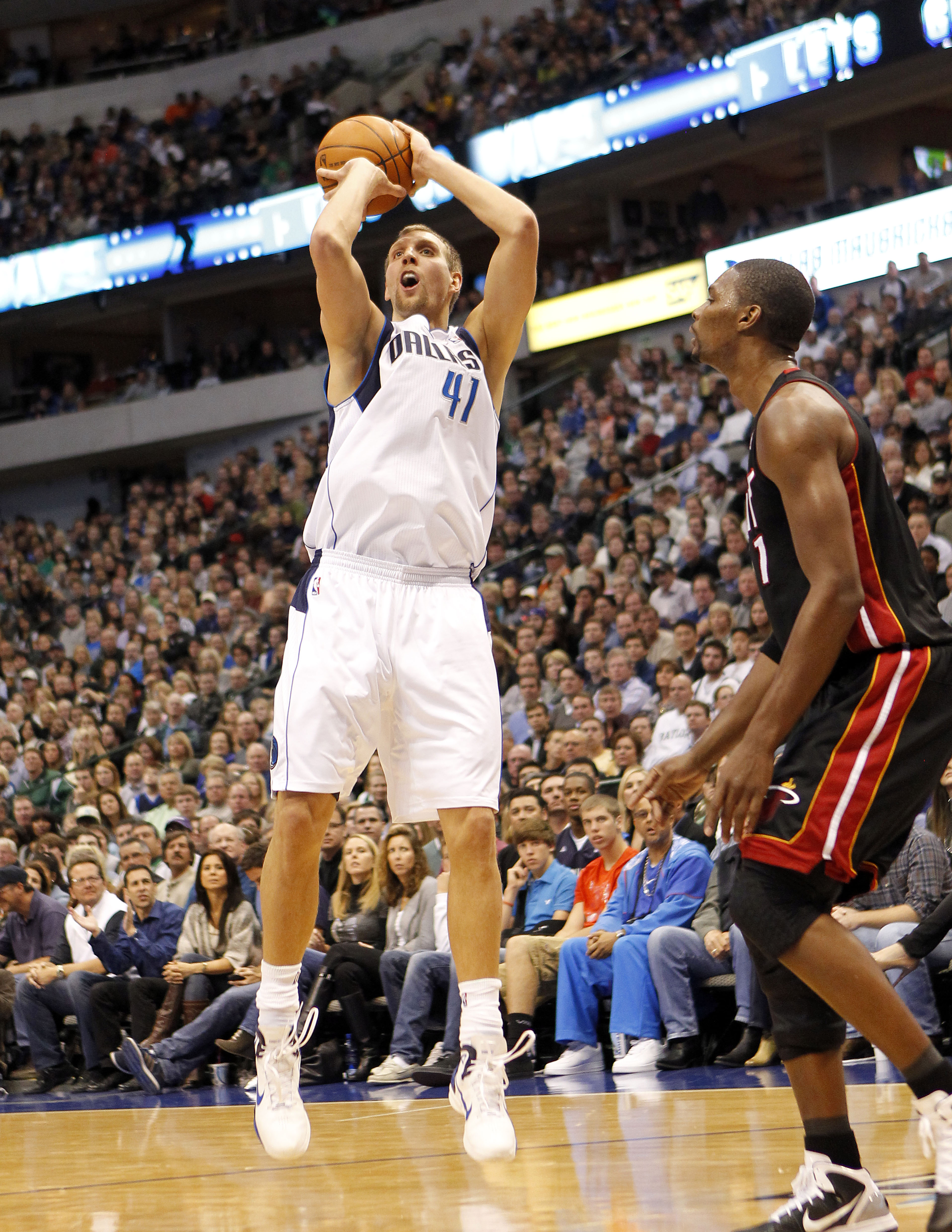 DALLAS - NOVEMBER 27: Dirk Nowitzki #41 of the Dallas Mavericks shoots over Chris Bosh #1 of the Miami Heat on November 27, 2010 at the American Airlines Center in Dallas, Texas. NOTE TO USER: User expressly acknowledges and agrees that, by downloading an