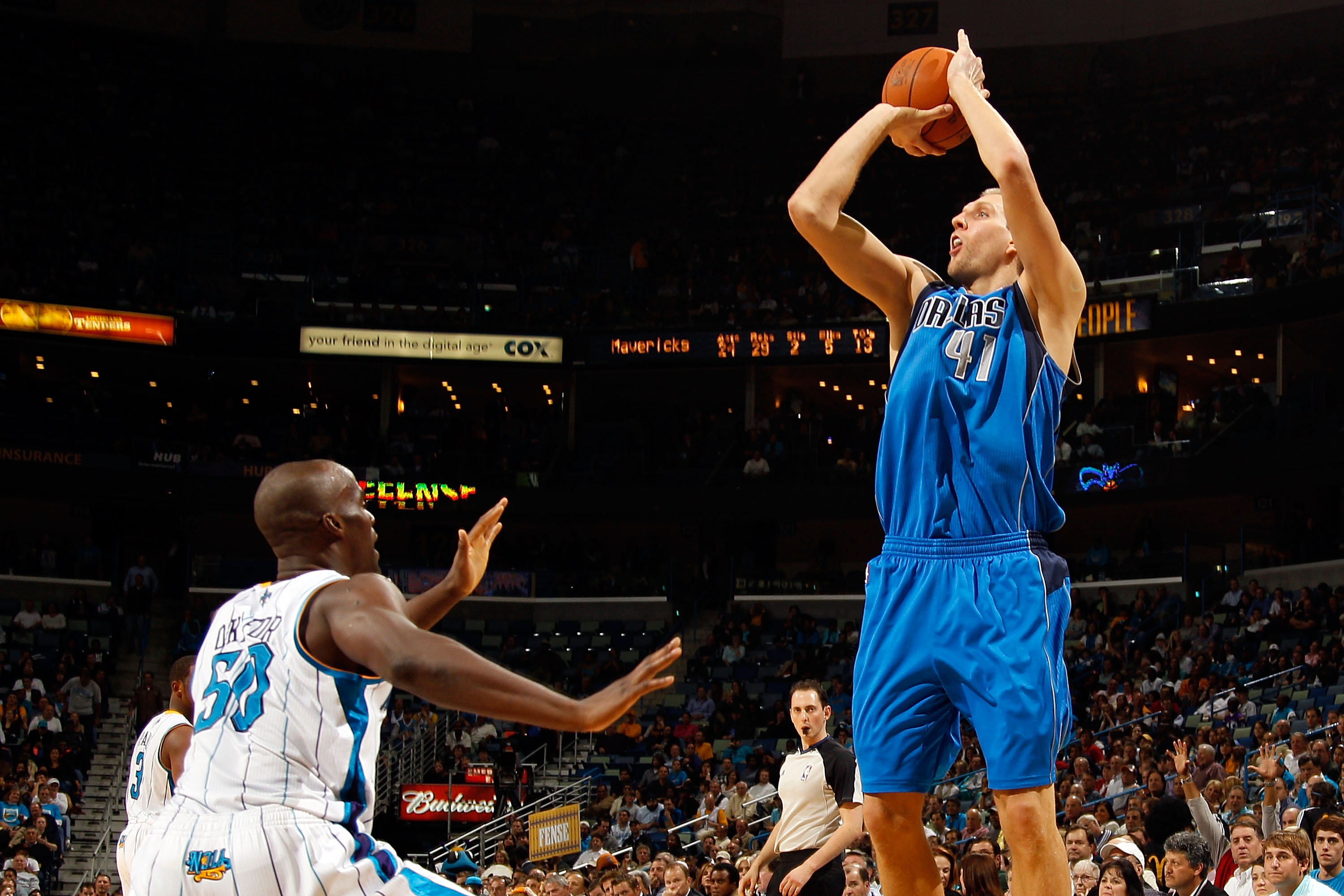 NEW ORLEANS - NOVEMBER 17:  Dirk Nowitzki #41 of the Dallas Mavericks shoots the ball over Emeka Okafor #50 of the New Orleans Hornets at the New Orleans Arena on November 17, 2010 in New Orleans, Louisiana.  The Hornets defeated the Mavericks 99-97.  NOT