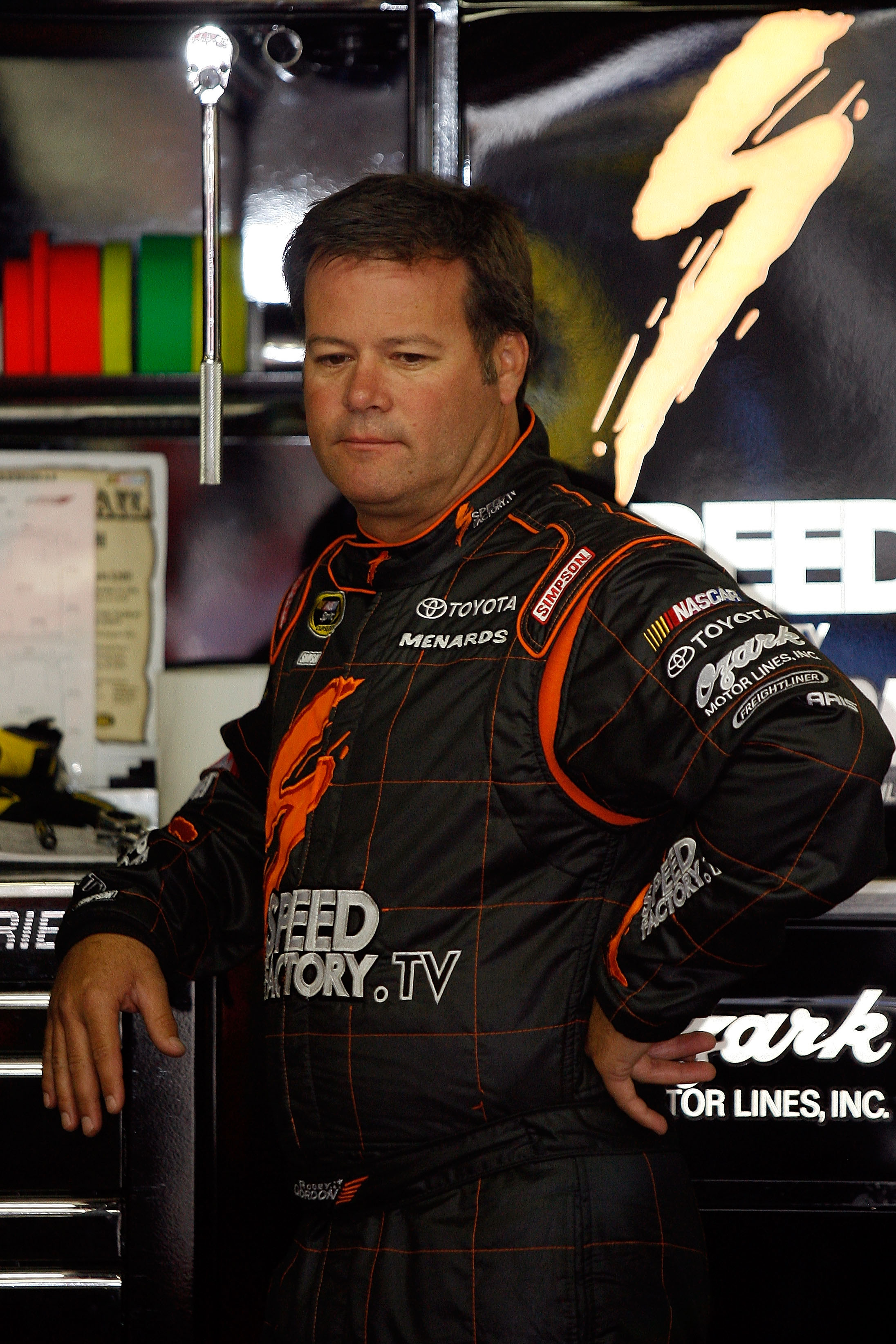 LOUDON, NH - SEPTEMBER 18:  Robby Gordon, driver of the #7 SpeedFactory.TV Toyota, looks on in the garage during practice for the NASCAR Sprint Cup Series Sylvania 300 at New Hampshire Motor Speedway on September 18, 2010 in Loudon, New Hampshire.  (Photo