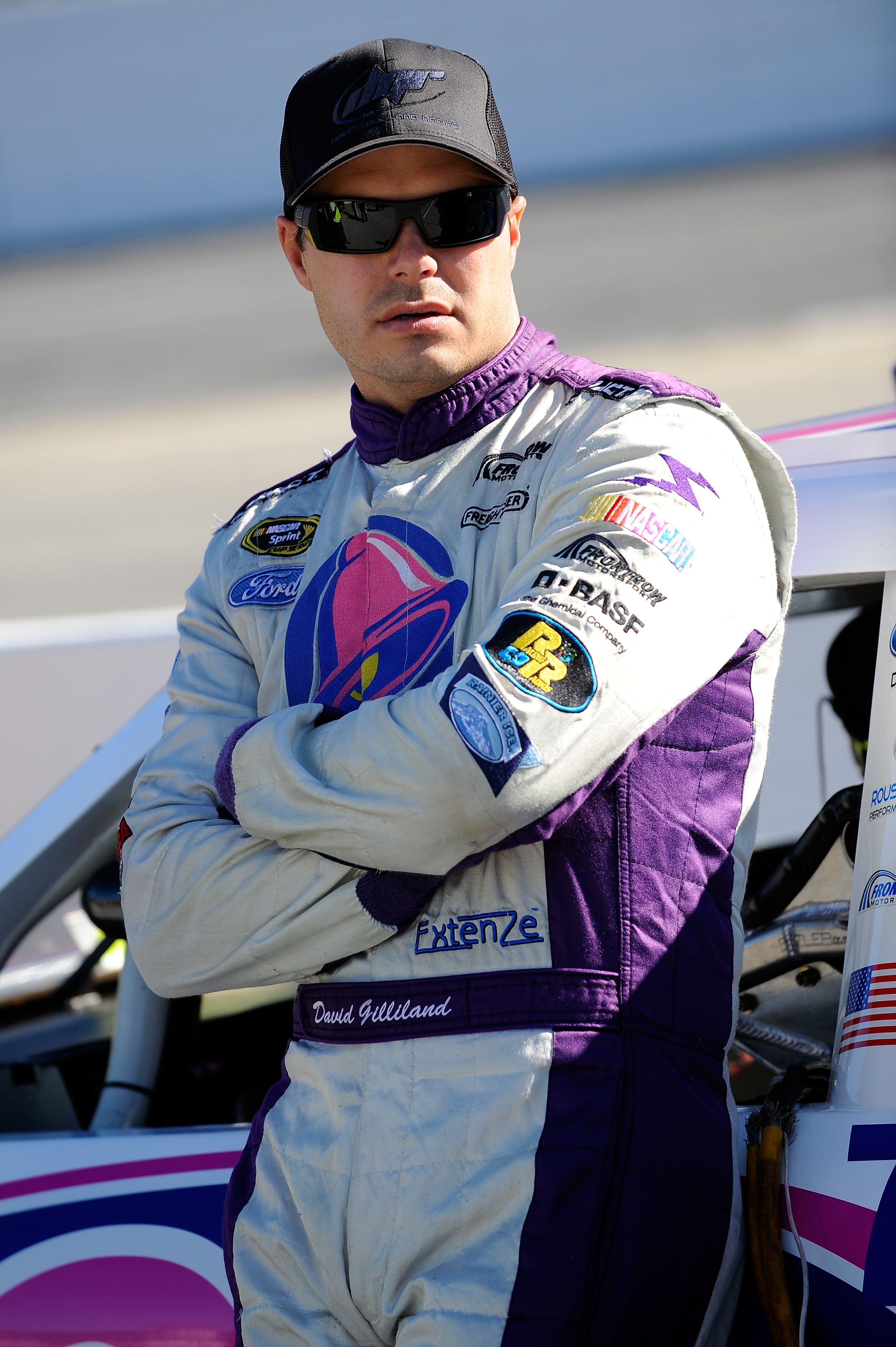 MARTINSVILLE, VA - OCTOBER 22:  David Gilliland, driver of the #37 Taco Bell Ford, stands on pit road during qualifying for the NASCAR Sprint Cup Series TUMS Fast Relief 500 at Martinsville Speedway on October 22, 2010 in Martinsville, Virginia.  (Photo b