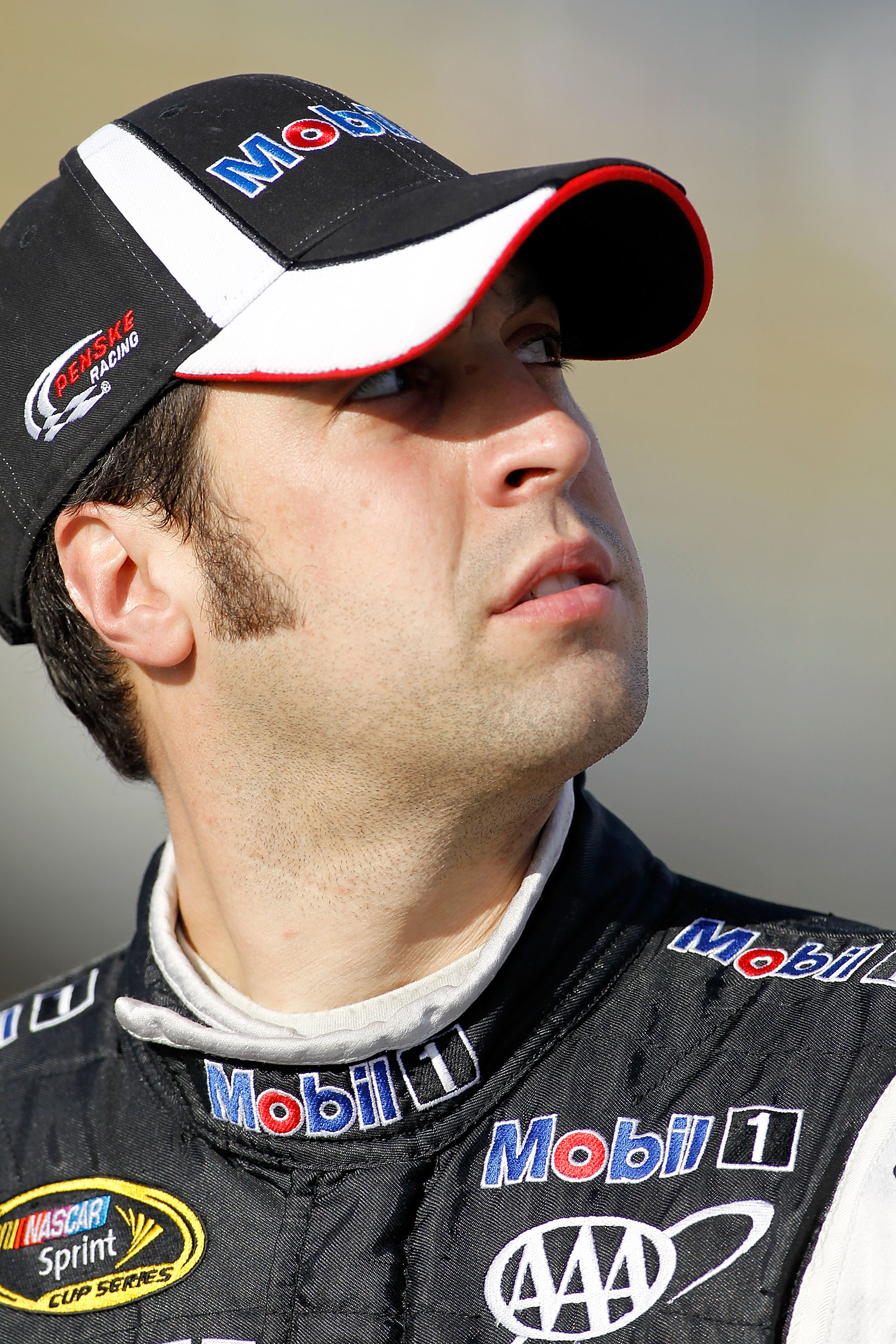 HOMESTEAD, FL - NOVEMBER 19:  Sam Hornish Jr., driver of the #77 Mobil 1 Dodge, stands on pit road during qualifying for the NASCAR Sprint Cup Series Ford 400 at Homestead-Miami Speedway on November 19, 2010 in Homestead, Florida.  (Photo by Todd Warshaw/