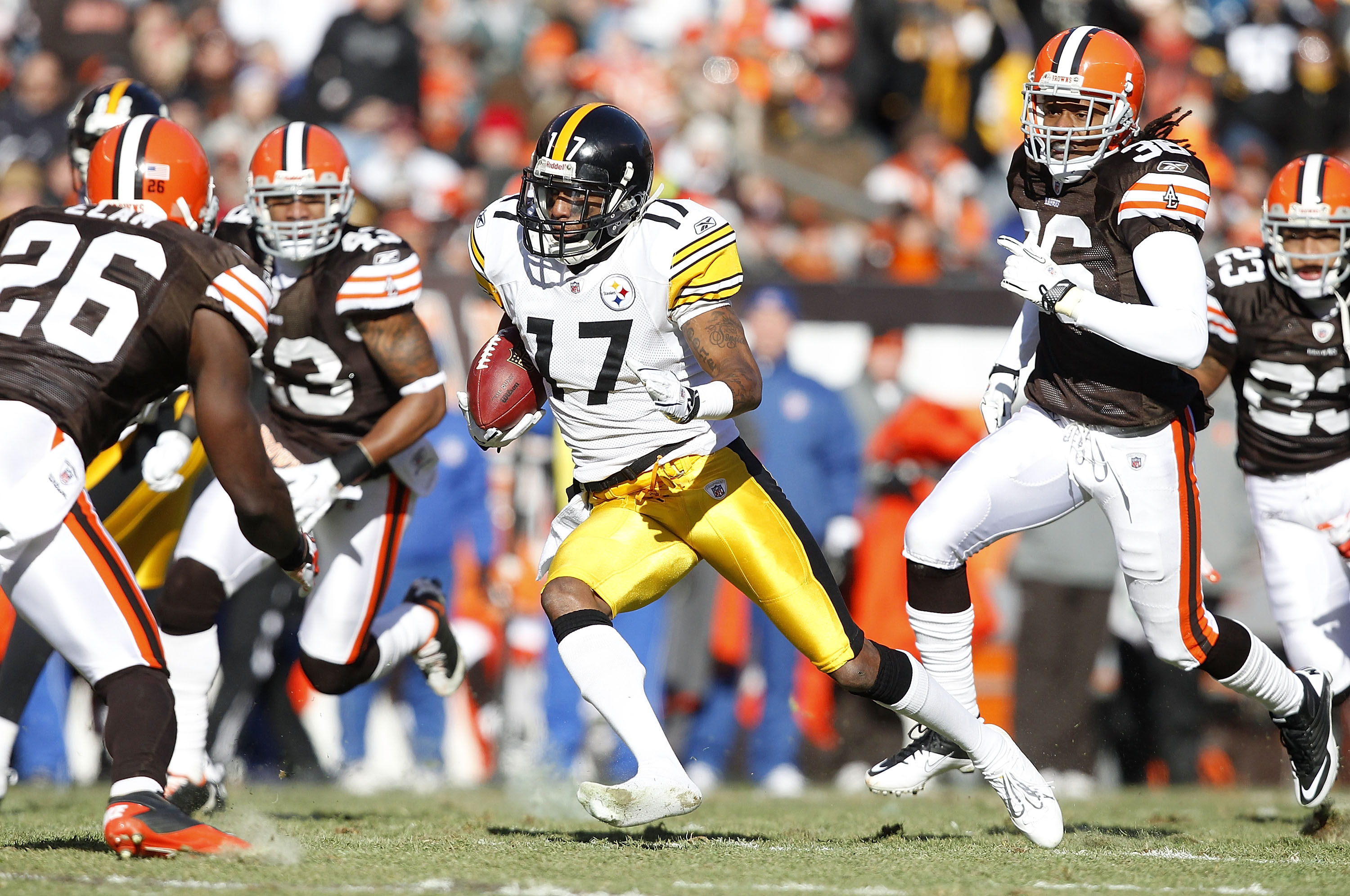 CLEVELAND, OH - JANUARY 02:  Wide receiver Mike Wallace #17 of the Pittsburgh Steelers runs the ball past defensive back Abram Elam #26, T.J. Ward #43 and Coye Francies #36 of the Cleveland Browns at Cleveland Browns Stadium on January 2, 2011 in Clevelan