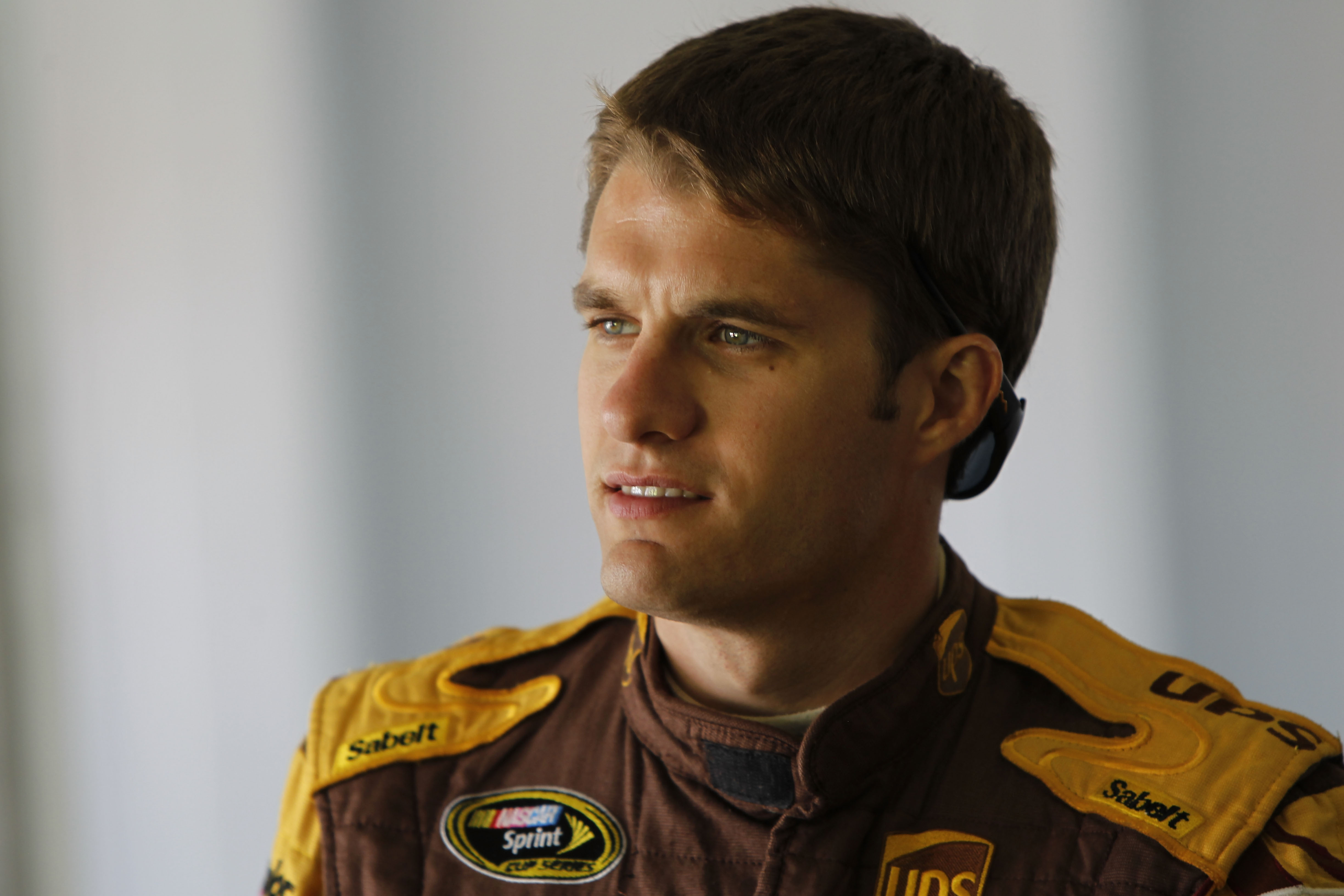 HOMESTEAD, FL - NOVEMBER 20:  David Ragan, driver of the #6 UPS Ford, walks in the garage during practice for the NASCAR Sprint Cup Series Ford 400 at Homestead-Miami Speedway on November 20, 2010 in Homestead, Florida.  (Photo by Chris Trotman/Getty Imag