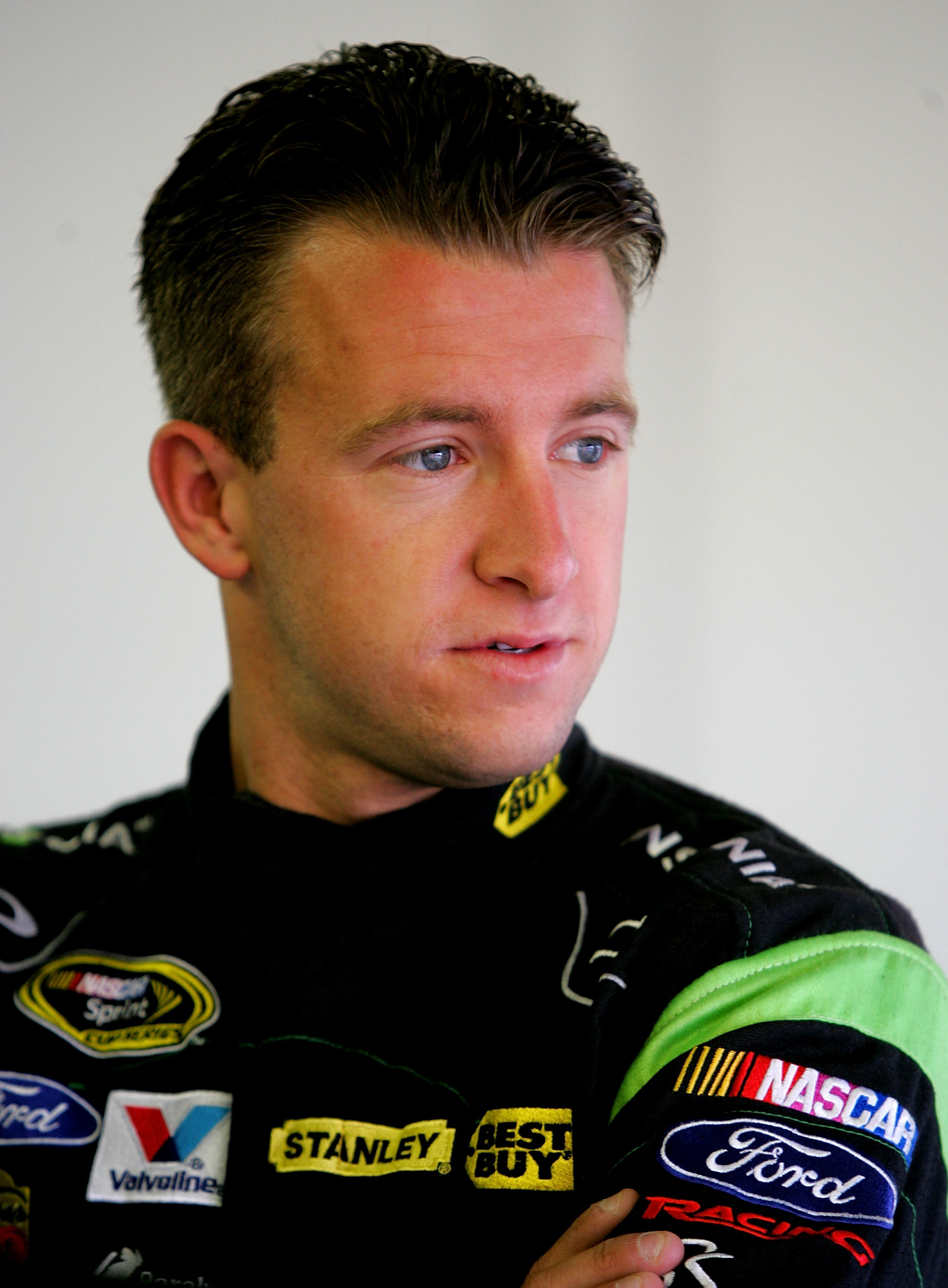 LOUDON, NH - SEPTEMBER 18:  A J Allmendinger, driver of the #43 Insignia HDTV Ford, stands in the garage during practice for the NASCAR Sprint Cup Series Sylvania 300 at New Hampshire Motor Speedway on September 18, 2010 in Loudon, New Hampshire.  (Photo