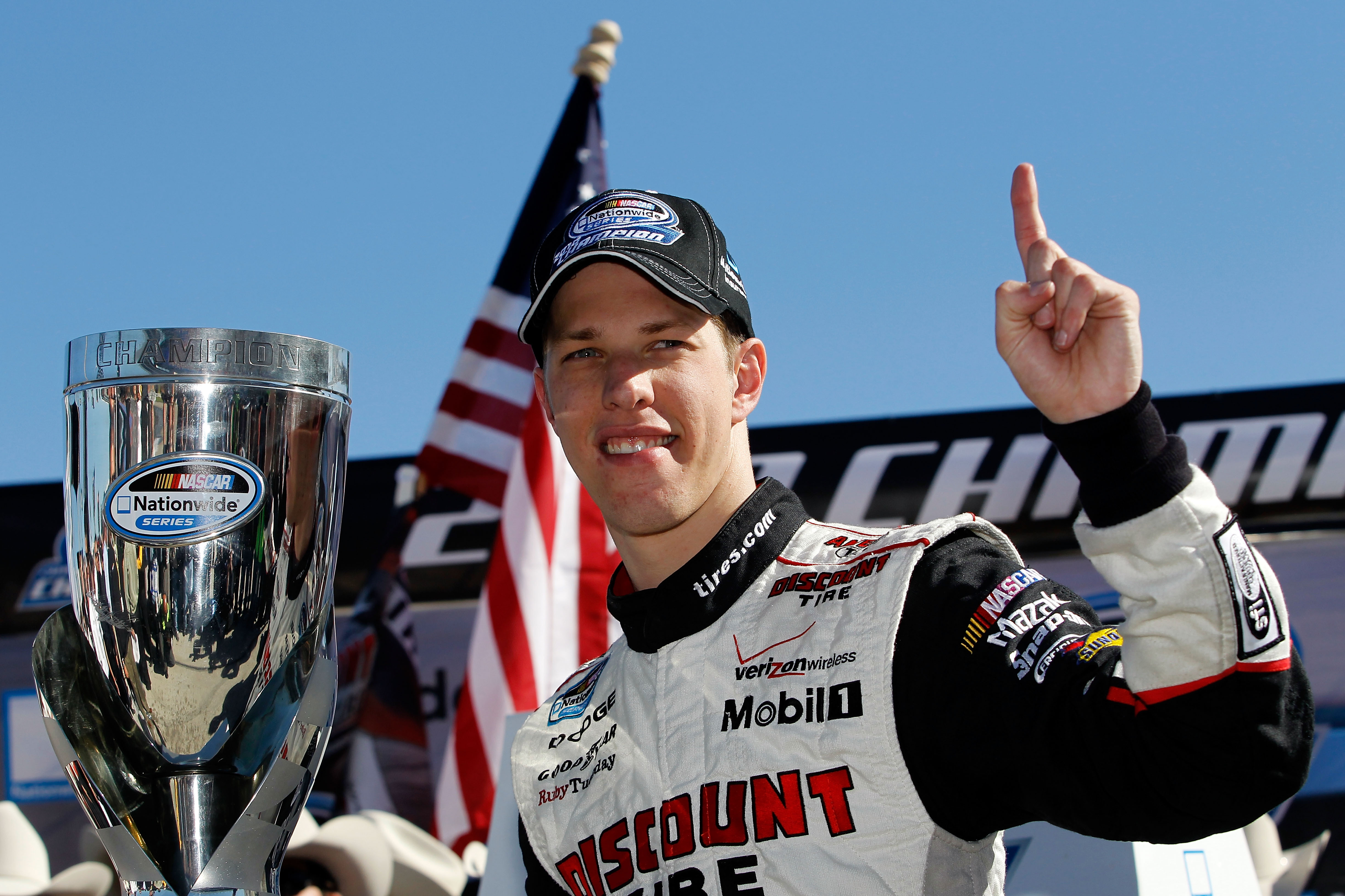 FORT WORTH, TX - NOVEMBER 06:  Brad Keselowski, driver of the #22 Discount Tire Dodge, celebrates after winning the Nationwide Championship with a third-place finish in the NASCAR Nationwide Series O'Reilly Auto Parts Challenge at Texas Motor Speedway on