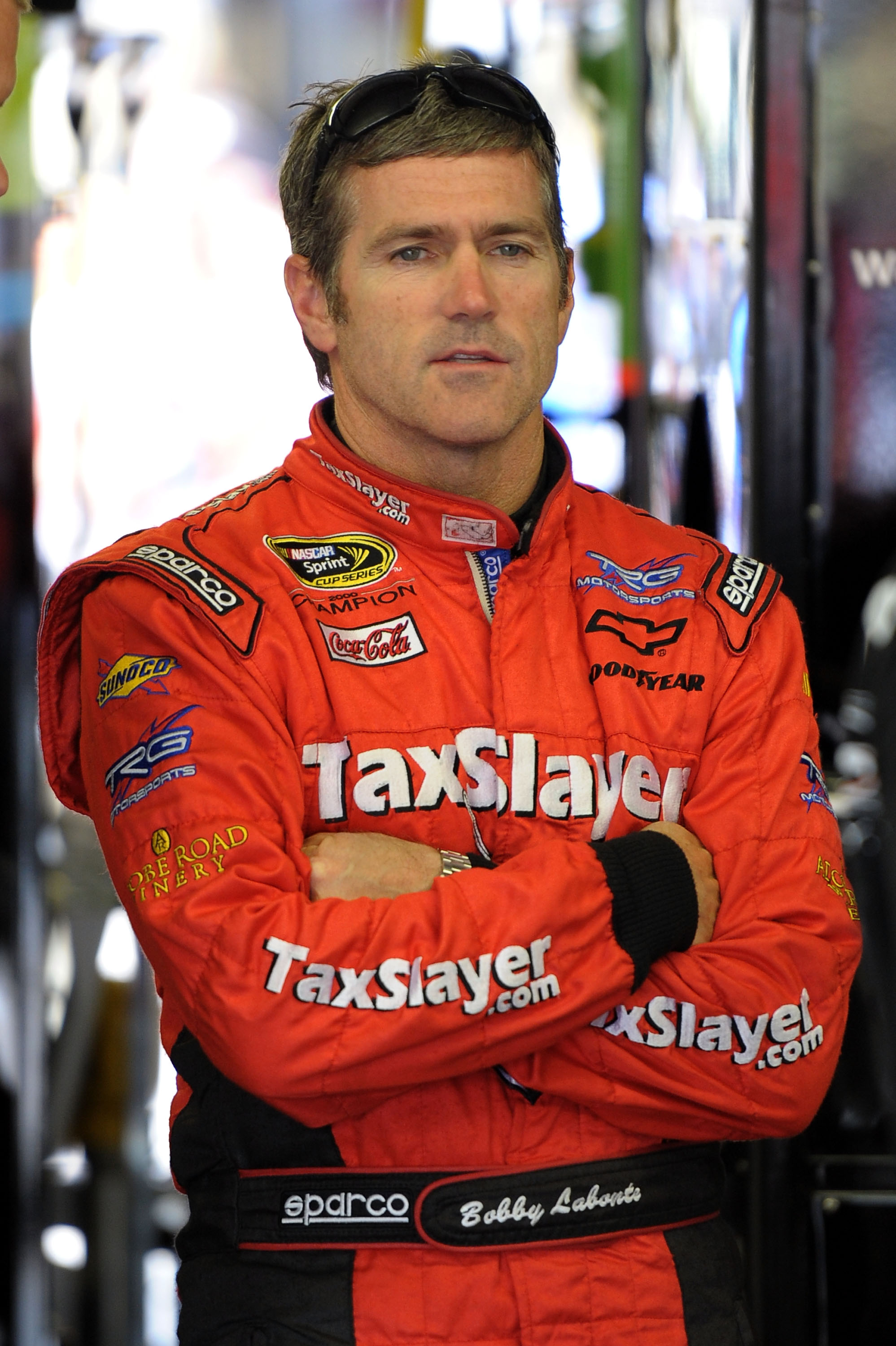 LOUDON, NH - JUNE 26:  Bobby Labonte, driver of the #7 SpeedFactory.TV Toyota, stands in the garage during practice for the NASCAR Sprint Cup Series LENOX Industrial Tools 301 at New Hampshire Motor Speedway on June 26, 2010 in Loudon, New Hampshire.  (Ph
