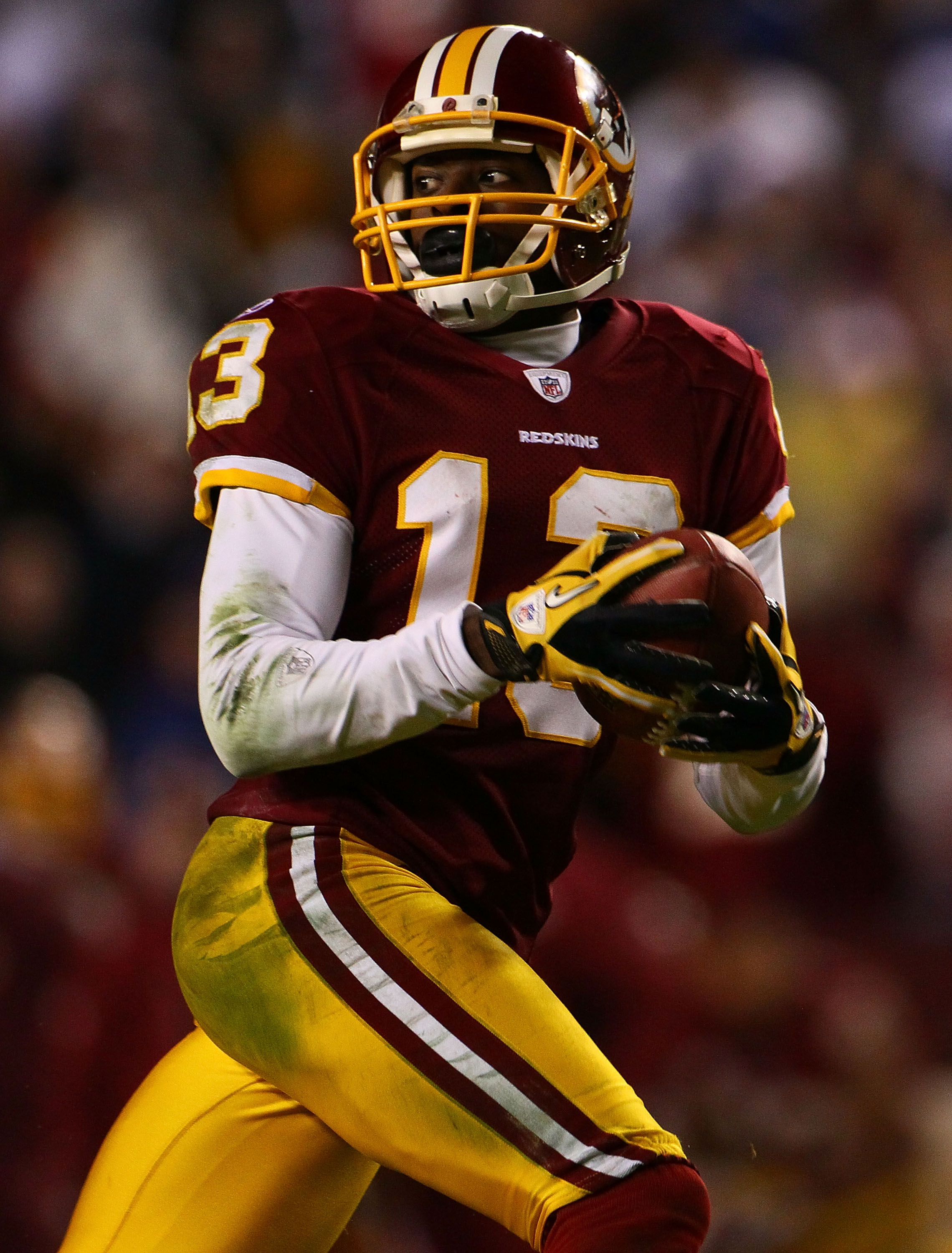 LANDOVER, MD - JANUARY 02:  Wide receiver Anthony Armstrong #13 of the Washington Redskins catches a touchdown pass against the New York Giants during a game at FedEx Field on January 2, 2011 in Landover, Maryland. The Giants won the game 17-14.  (Photo b