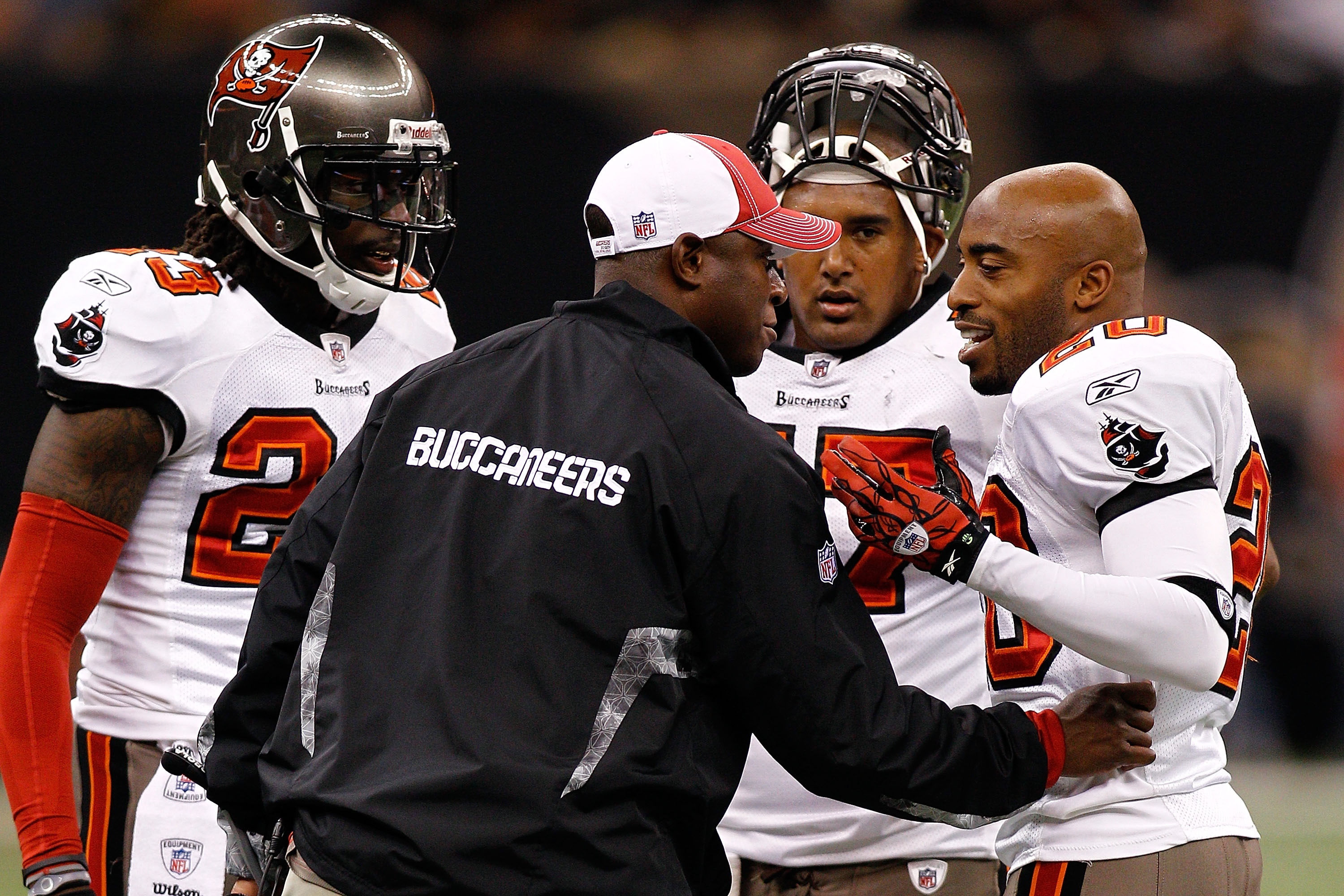 NEW ORLEANS, LA - JANUARY 02:  Head coach Raheem Morris talks with Ronde Barber #20 of the Tampa Bay Buccaneers during the game against the New Orleans Saints at the Louisiana Superdome on January 2, 2011 in New Orleans, Louisiana.  The Buccaneers defeate