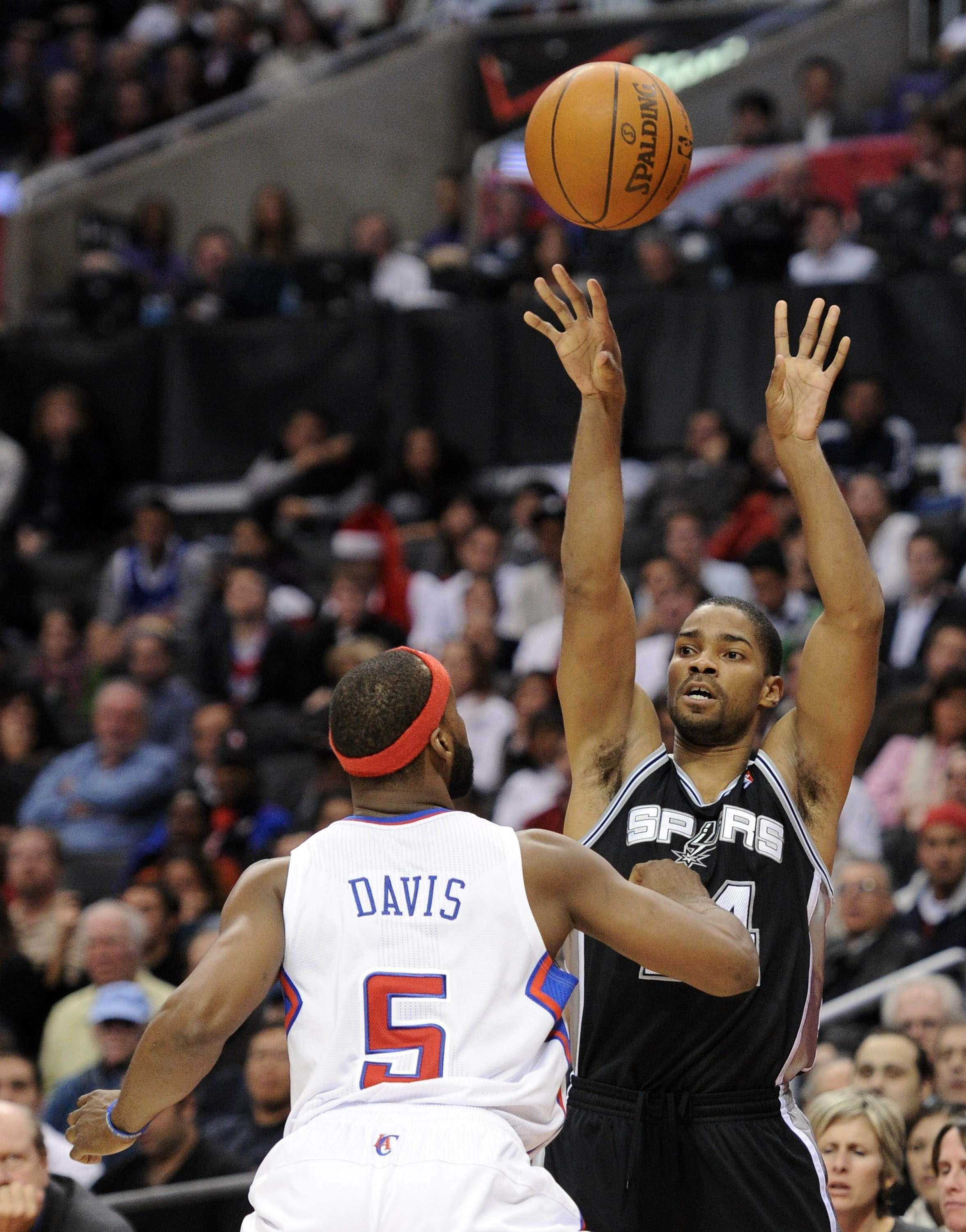 LOS ANGELES, CA - DECEMBER 01:  Gary Neal #14 of the San Antonio Spurs makes a pass over Baron Davis #5 of the Los Angeles Clippers at the Staples Center on December 1, 2010 in Los Angeles, California.  NOTE TO USER: User expressly acknowledges and agrees