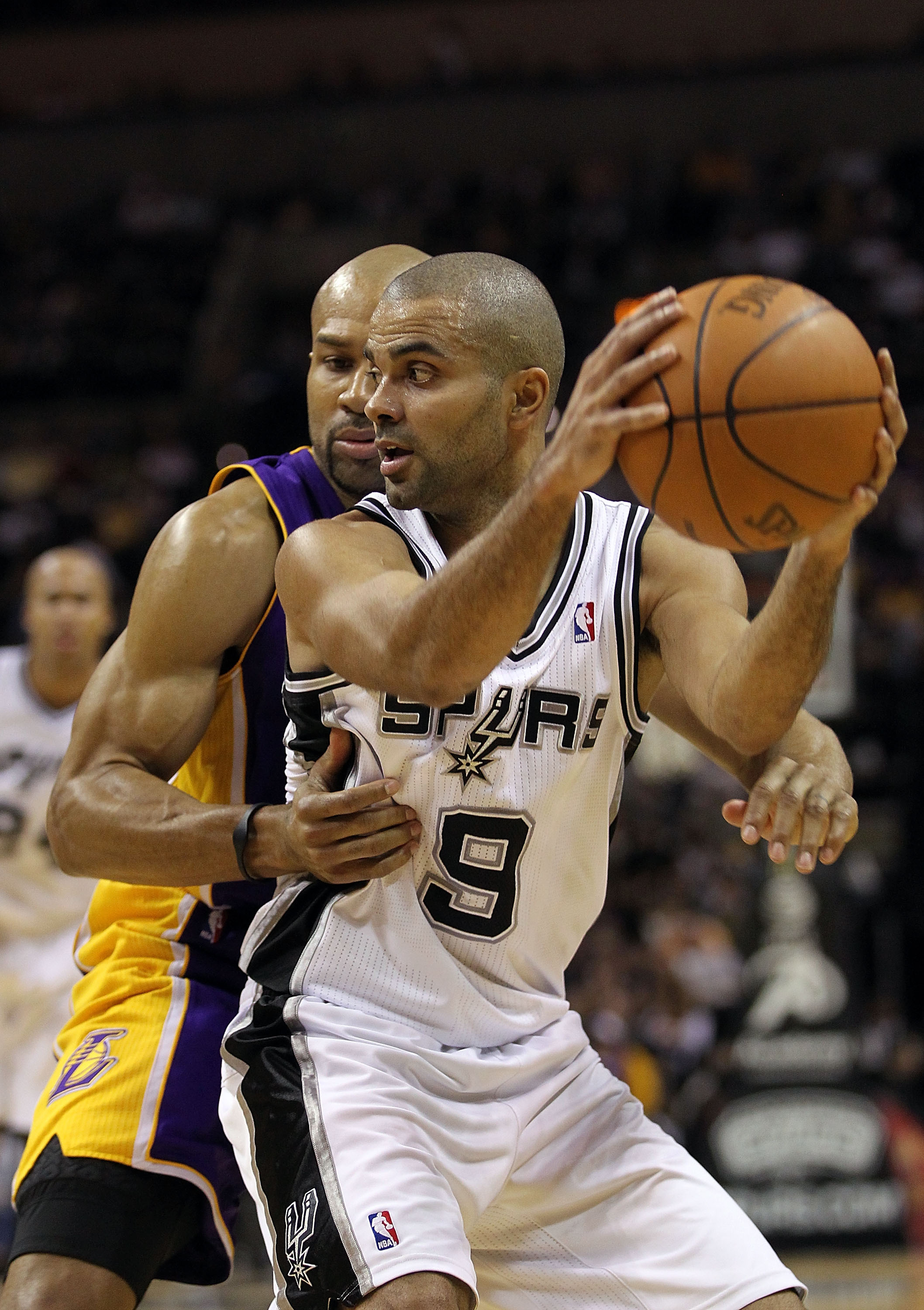 SAN ANTONIO, TX - DECEMBER 28:  Guard Tony Parker #9 of the San Antonio Spurs dribbles the ball against Derek Fisher #2 of the Los Angeles Lakers at AT&T Center on December 28, 2010 in San Antonio, Texas.    NOTE TO USER: User expressly acknowledges and a