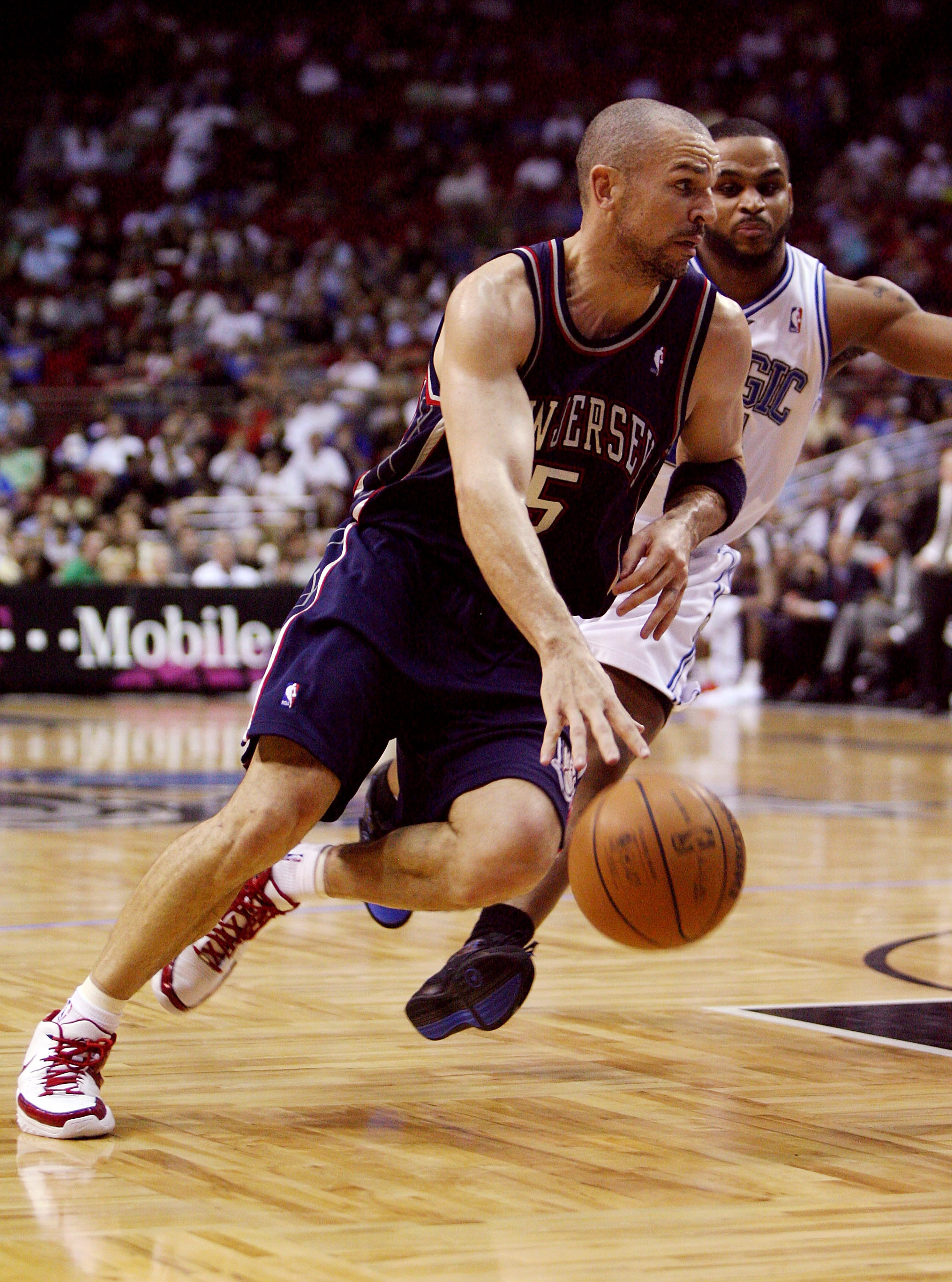 ORLANDO, FL - FEBRUARY 06:  Jason Kidd #5 of the New Jersey Nets drives past Jameer Nelson #14 of the Orlando Magic at Amway Arena on February 6, 2008 in Orlando, Florida. NOTE TO USER: User expressly acknowledges and agrees that, by downloading and or us
