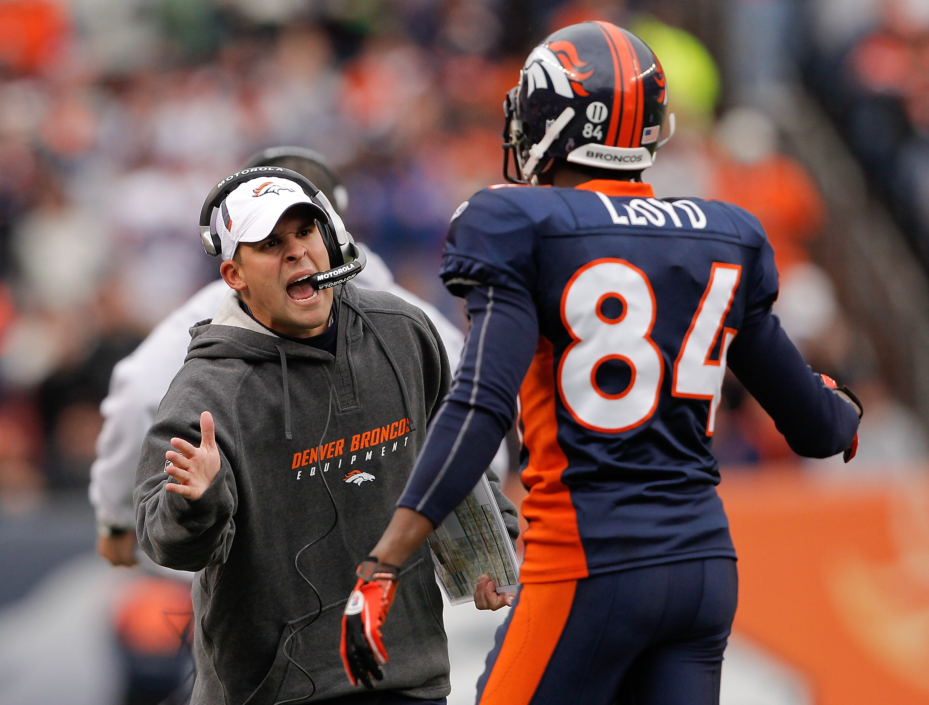 DENVER - NOVEMBER 28:  Head coach Josh McDaniels of the Denver Broncos celebrates a touchdown by Knowshon Moreno with wide receiver Brandon Lloyd #84 against the St. Louis Rams at INVESCO Field at Mile High on November 28, 2010 in Denver, Colorado. The Ra