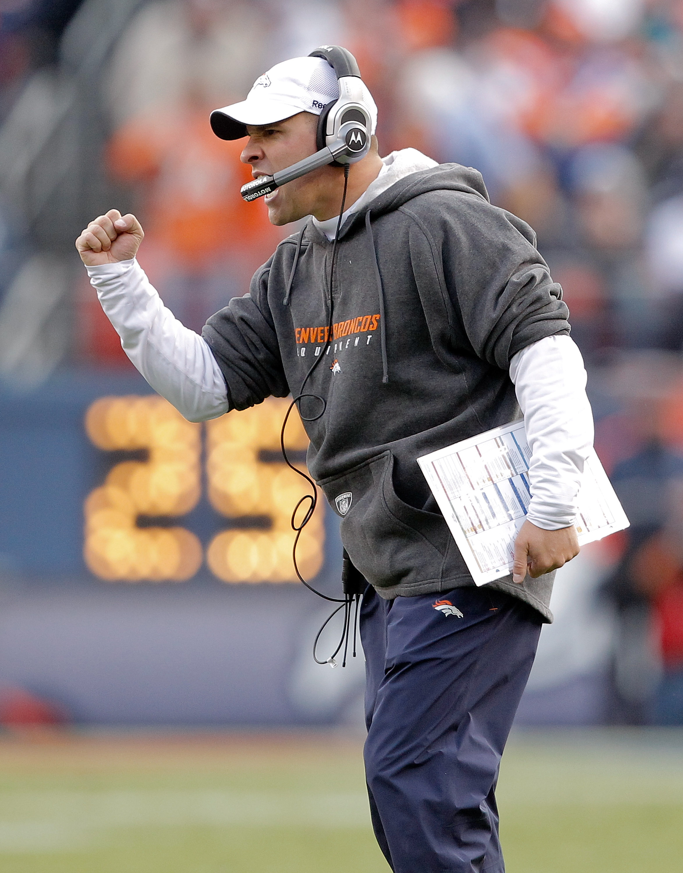DENVER - NOVEMBER 14:  Head coach Josh McDaniels of the Denver Broncos celebrates a touchdown on the sidelines against the Kansas City Chiefs during the second quarter at INVESCO Field at Mile High on November 14, 2010 in Denver, Colorado. The Denver Bron