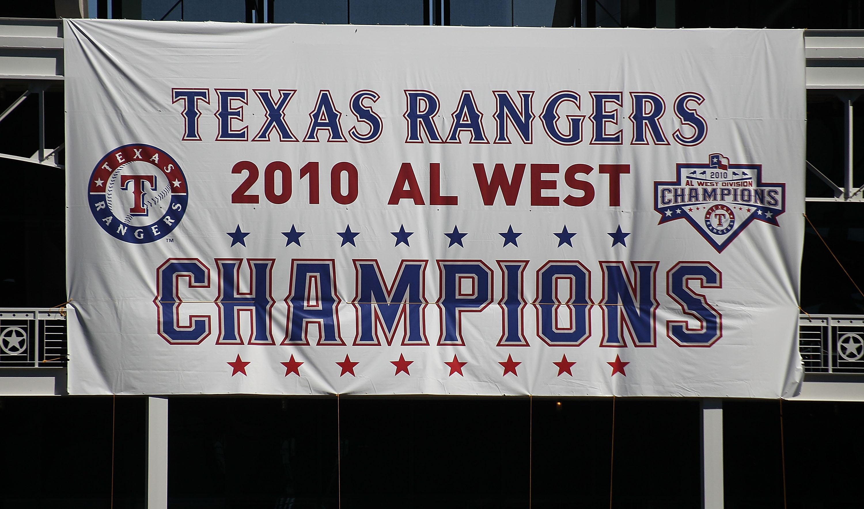 ARLINGTON, TX - SEPTEMBER 29:  A Texas Rangers AL West champions banner hangs at Rangers Ballpark in Arlington on September 29, 2010 in Arlington, Texas.  (Photo by Ronald Martinez/Getty Images)