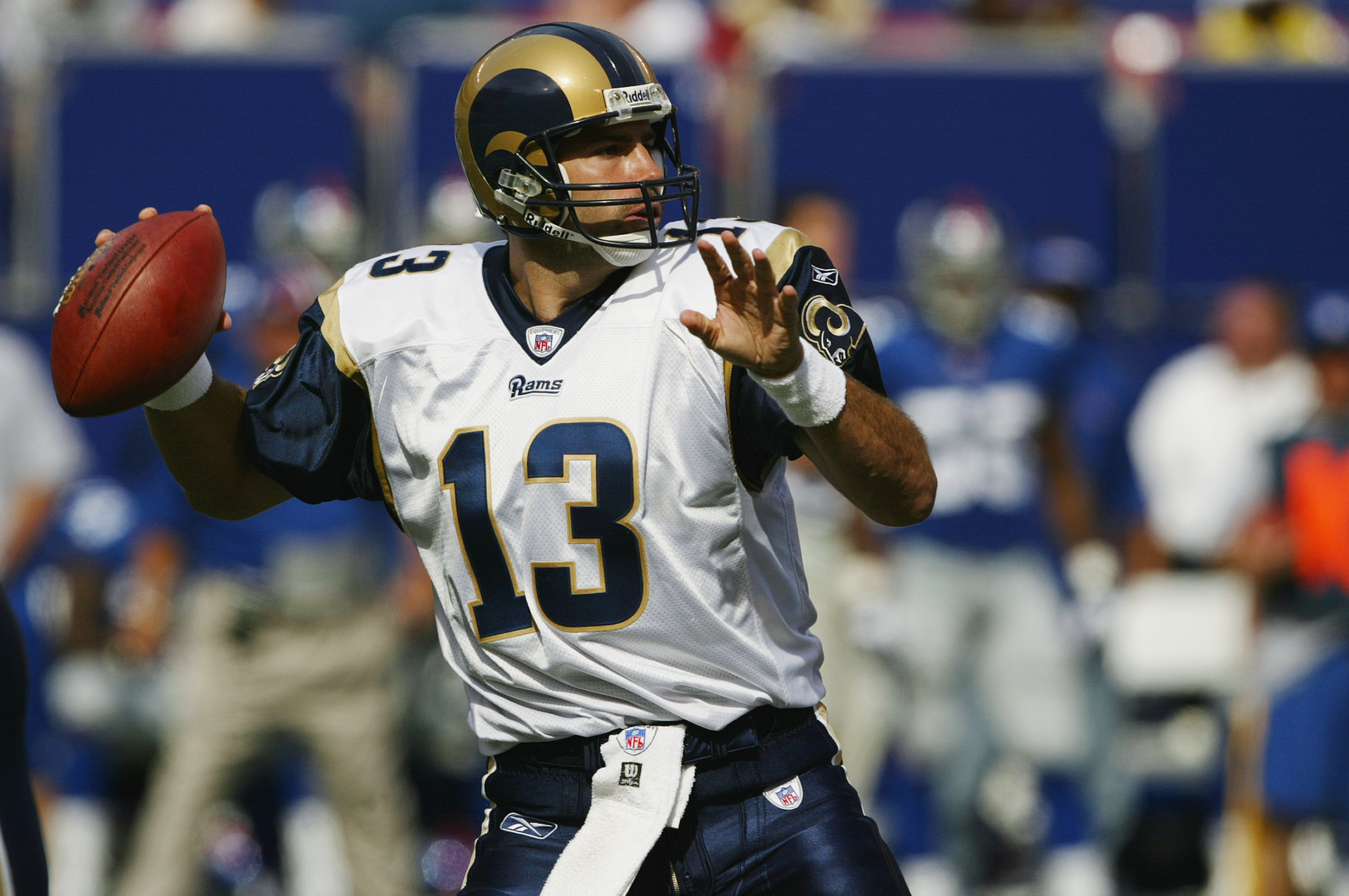 EAST RUTHERFORD, NJ - SEPTEMBER 7:  Quarterback Kurt Warner #13 of the St. Louis Rams throws a pass against the New York Giants during the game at the Giants Stadium on September 7, 2003 in East Rutherford, New Jersey. The Giants defeated the Rams 23-13.