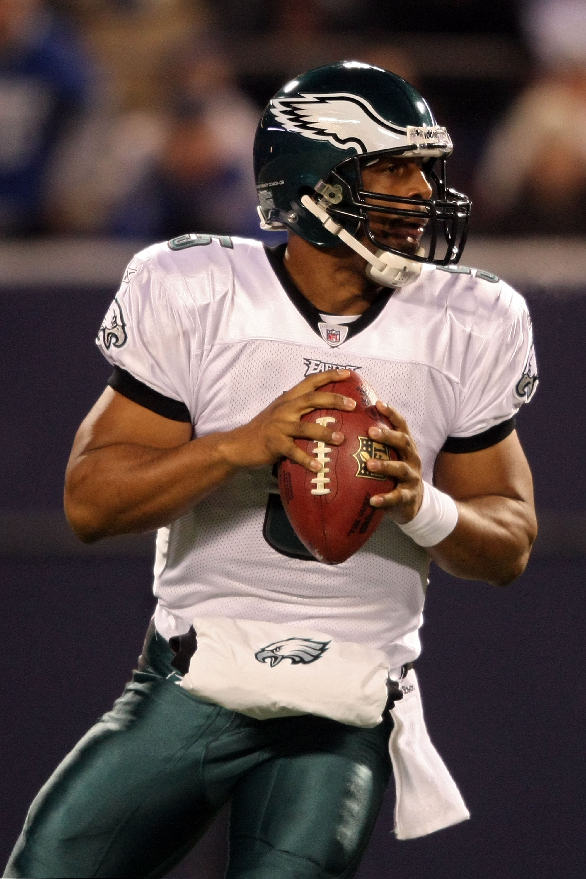 EAST RUTHERFORD, NJ - DECEMBER 13:  Donovan McNabb #5 of the Philadelphia Eagles drops against the New York Giants at Giants Stadium on December 13, 2009 in East Rutherford, New Jersey.  (Photo by Nick Laham/Getty Images)