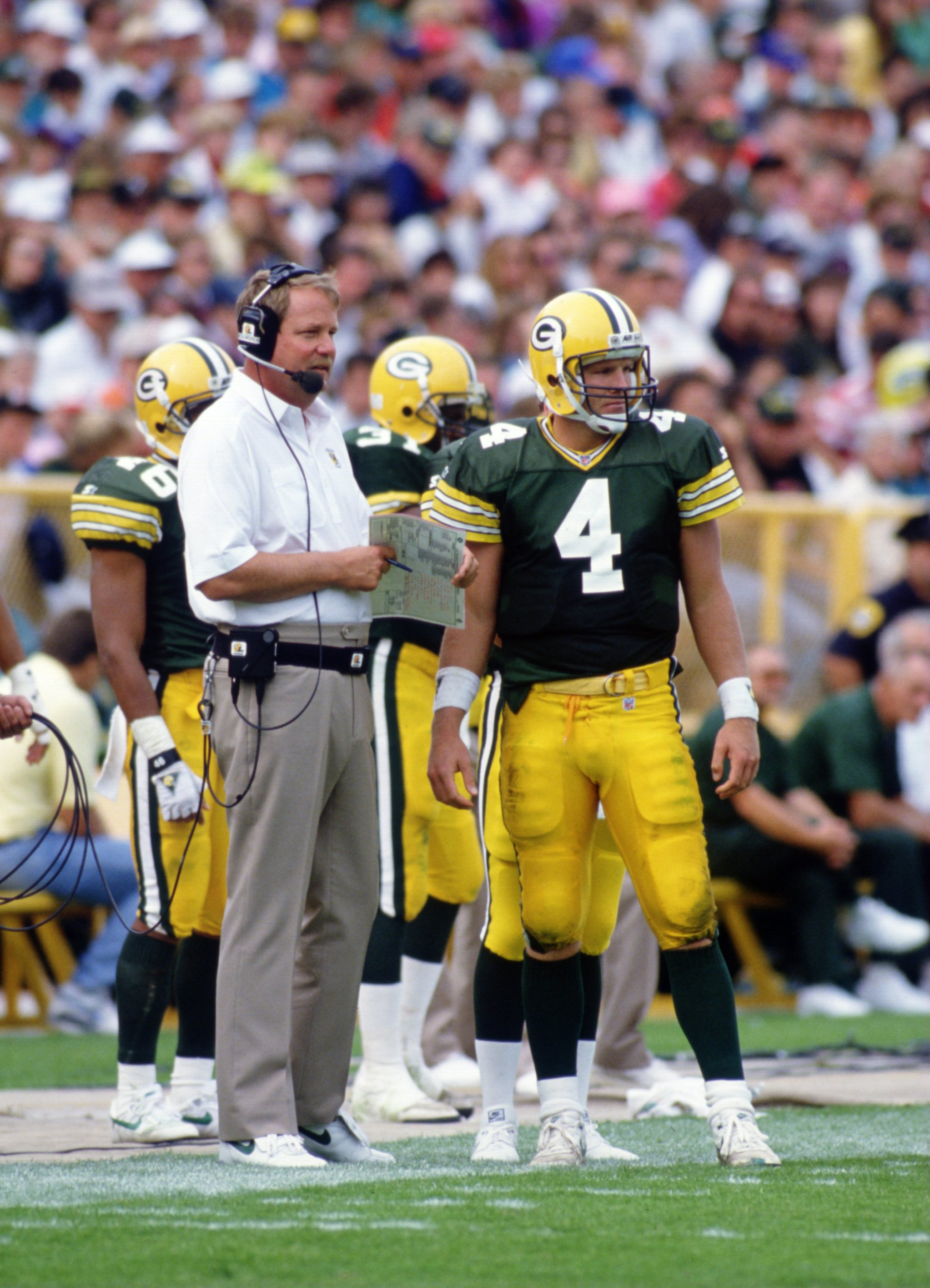 20 SEP 1992:  HEAD COACH MIKE HOLMGREN OF THE GREEN BAY PACKERS TALKS TO QUARTERBACK BRETT FAVRE DURING THE PACKERS 24-23 WIN OVER THE CINCINNATI BENGALS AT LAMBEAU FIELD IN GREEN BAY, WISCONSIN. Mandatory Credit: Jonathan Daniel/ALLSPORT