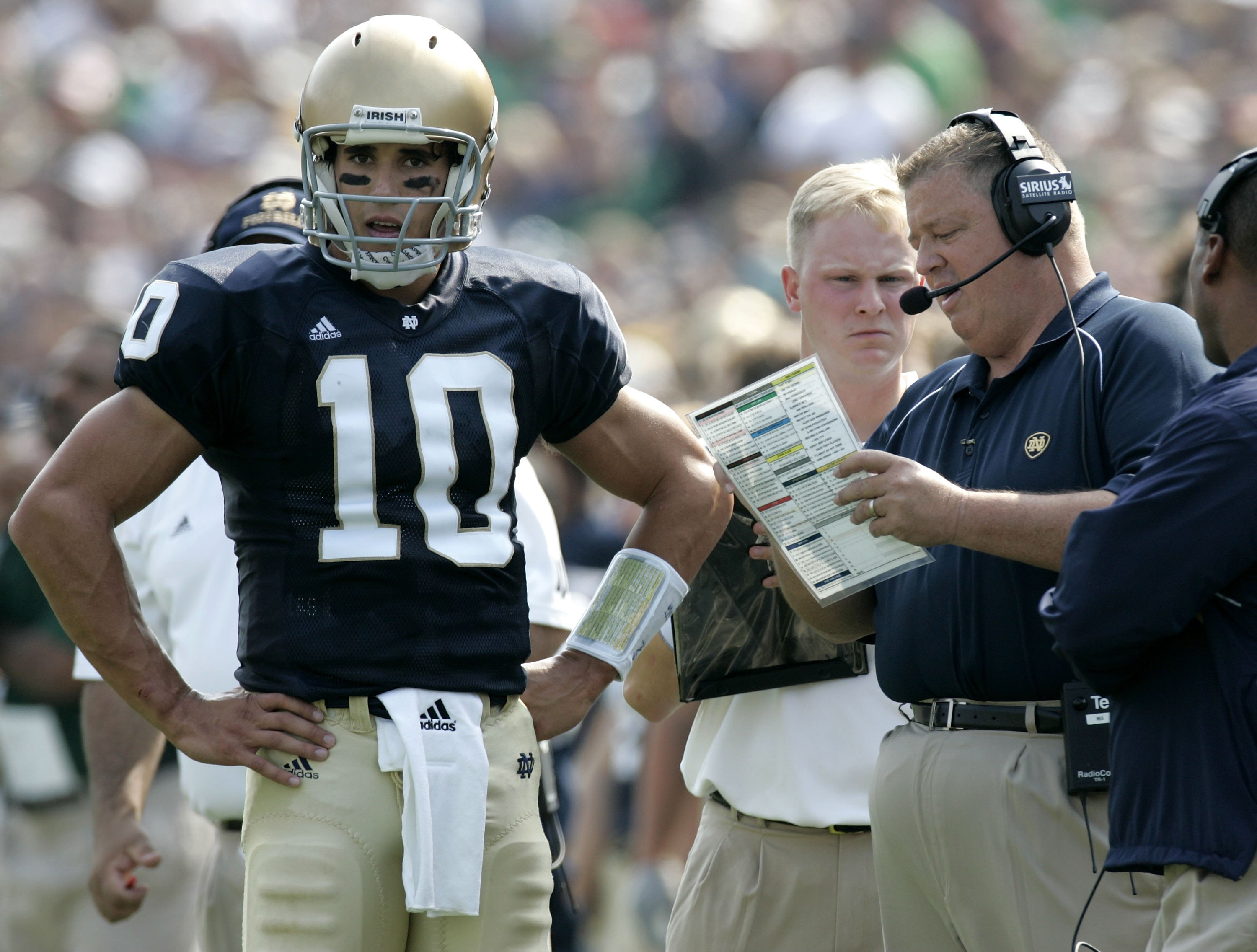 SOUTH BEND, IN - SEPTEMBER 9:  Brady Quinn #10 of the Notre Dame Fighting Irish talks with head coach Charlie Weis during a game against the Penn State Nittany Lions on September 9, 2006 at Notre Dame Stadium in South Bend, Indiana. Notre Dame won the gam