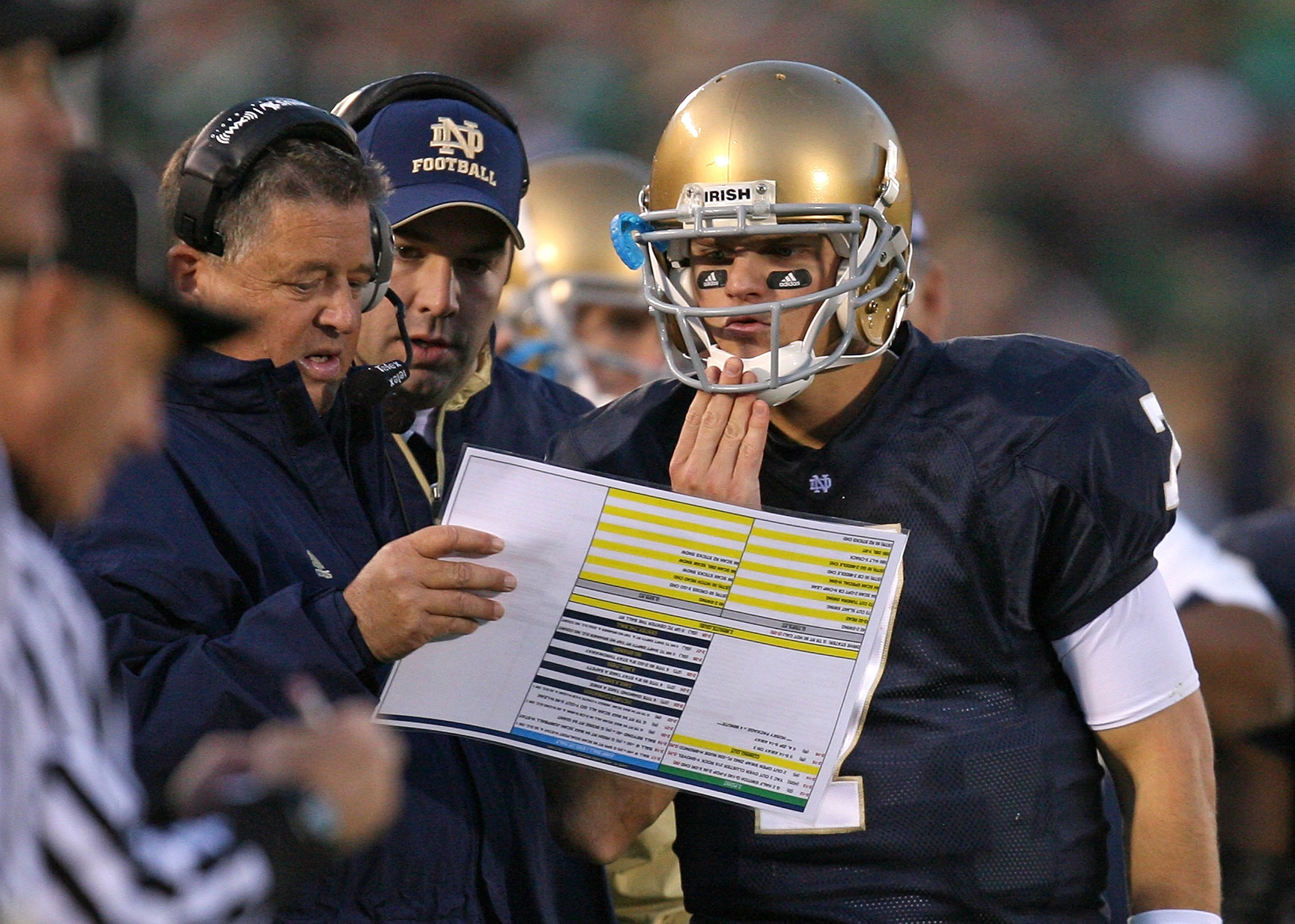 SOUTH BEND, IN - OCTOBER 17: Head coach Charlie Weis of the Notre Dame Fighting Irish gives a play to quarterback Jimmy Clausen #7 during a game against the USC Trojans at Notre Dame Stadium on October 17, 2009 in South Bend, Indiana. USC defeated Notre D