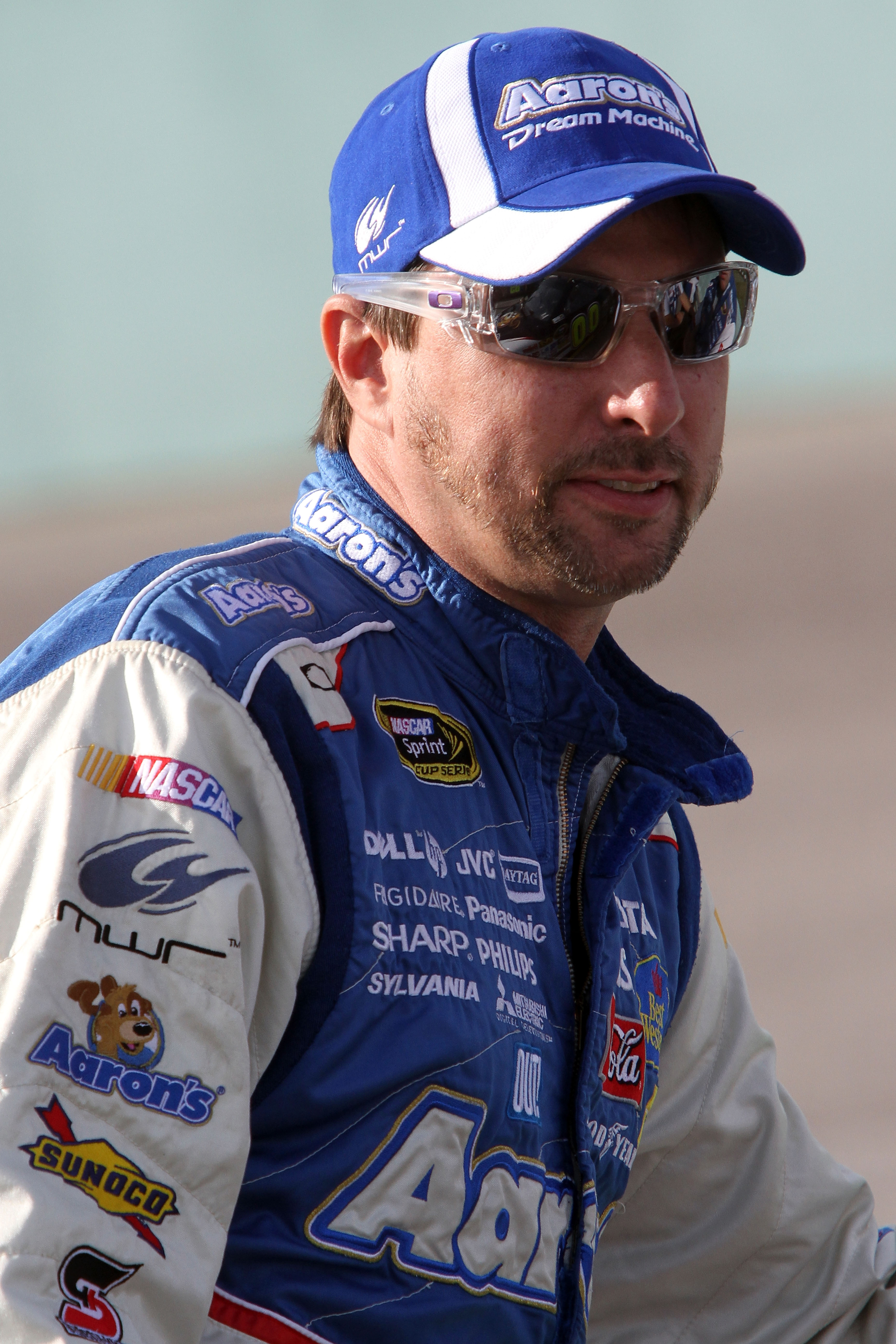 HOMESTEAD, FL - NOVEMBER 19:  David Reutimann, driver of the #00 Aaron's Dream Machine Toyota, sits on pit road wall during qualifying for the NASCAR Sprint Cup Series Ford 400 at Homestead-Miami Speedway on November 19, 2010 in Homestead, Florida.  (Phot