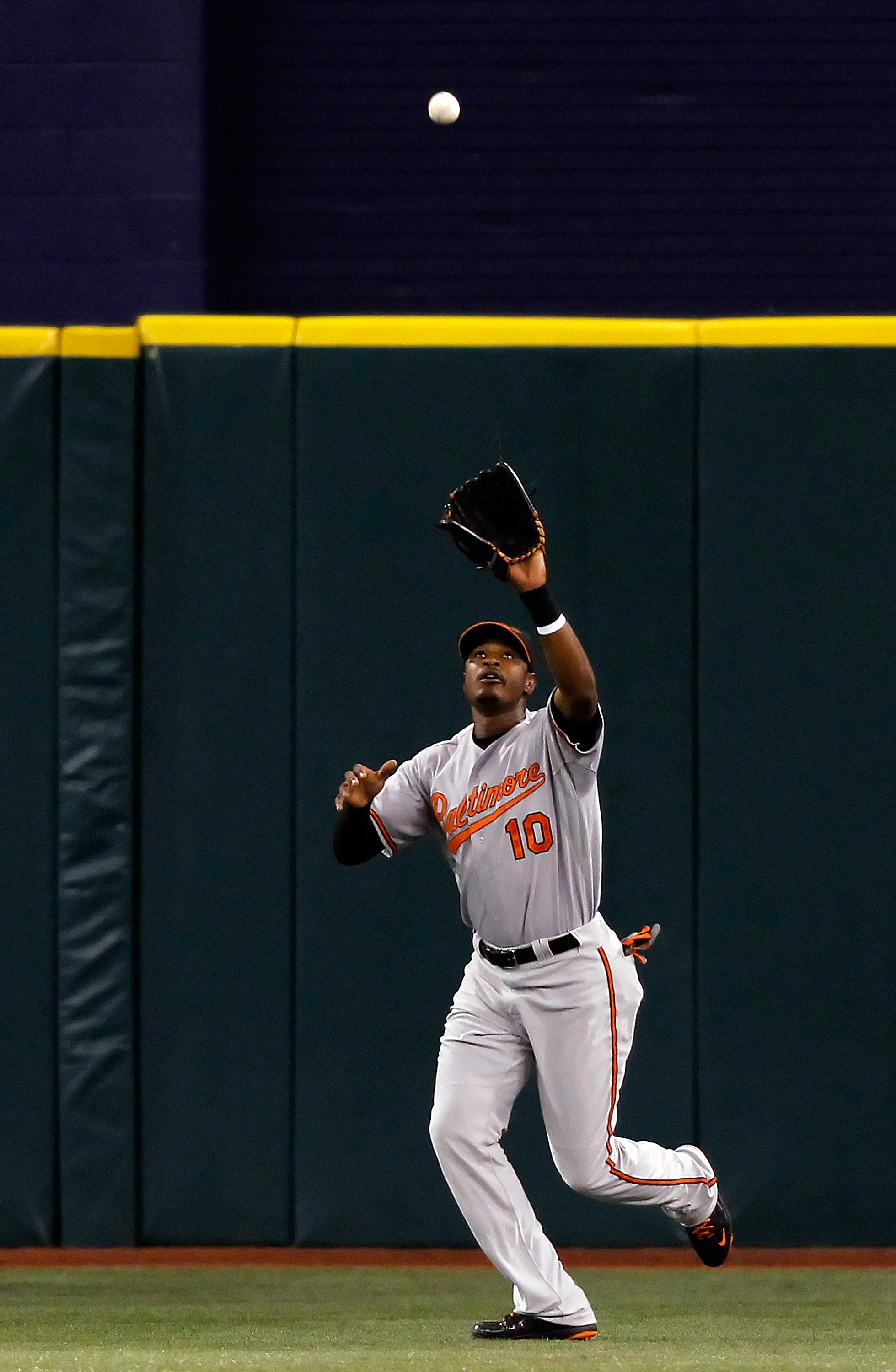 ST. PETERSBURG, FL - SEPTEMBER 28:  Outfielder Adam Jones #10 of the Baltimore Orioles catches a fly ball against the Tampa Bay Rays during the game at Tropicana Field on September 28, 2010 in St. Petersburg, Florida.  (Photo by J. Meric/Getty Images)