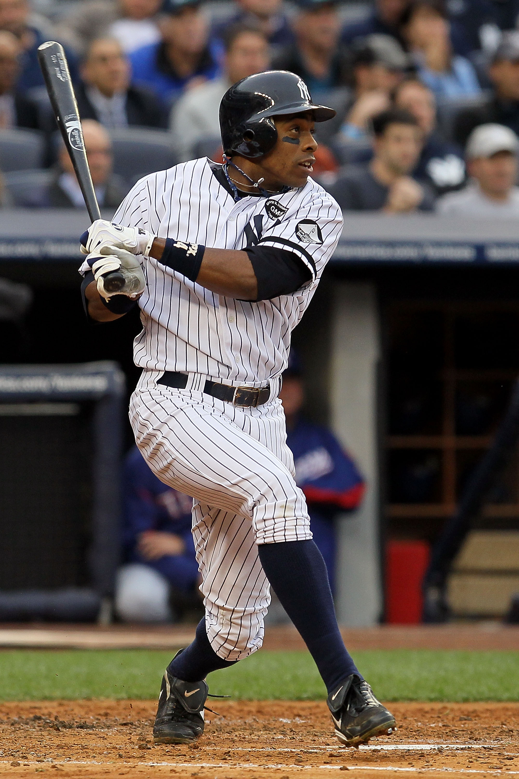 NEW YORK - OCTOBER 20:  Curtis Granderson #14 of the New York Yankees hits a single in the bottom of the second inning against the Texas Rangers in Game Five of the ALCS during the 2010 MLB Playoffs at Yankee Stadium on October 20, 2010 in the Bronx borou