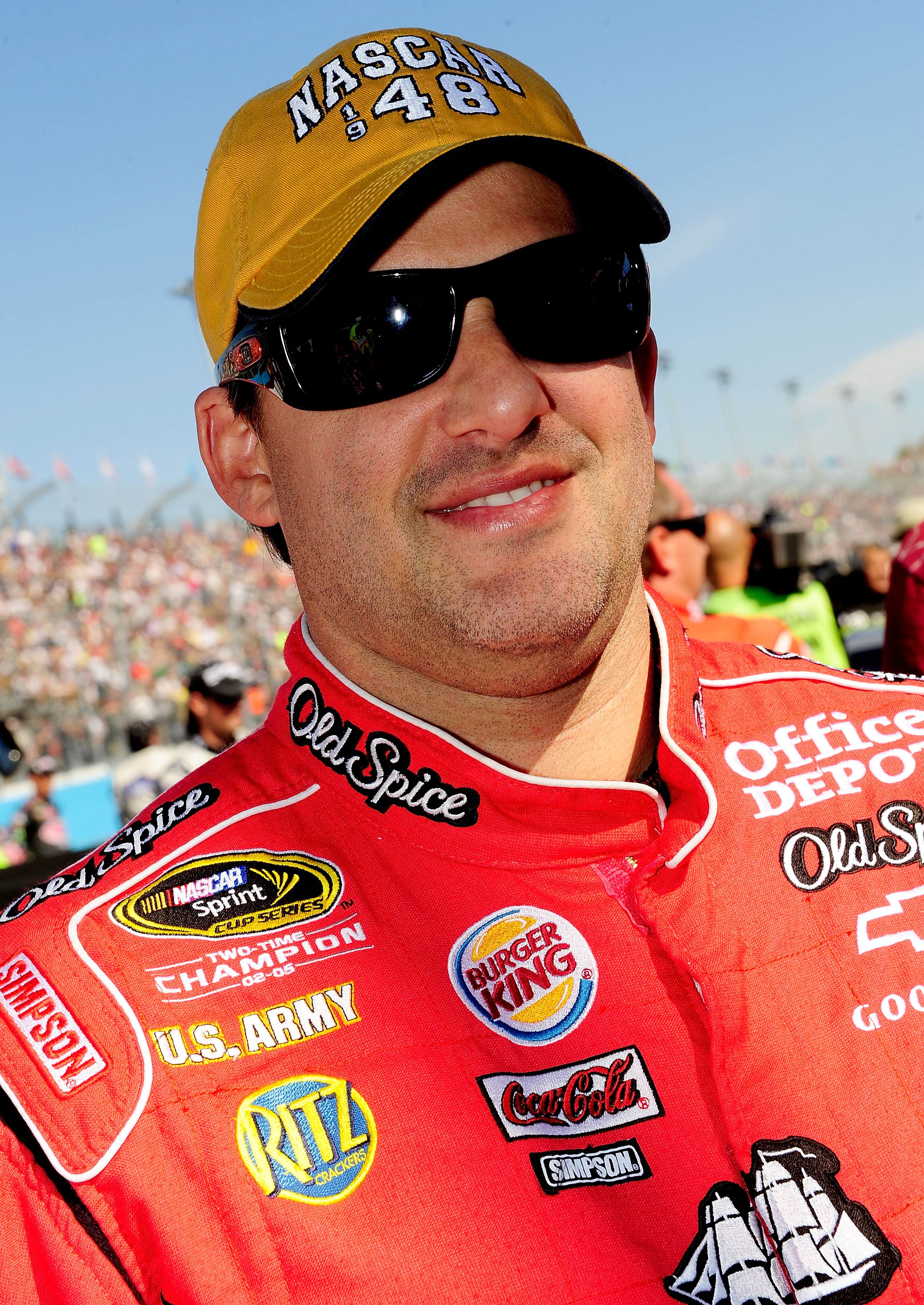 AVONDALE, AZ - NOVEMBER 14:  Tony Stewart, driver of the #14 Old Spice/Office Depot Chevrolet, stands on the starting grid prior to the NASCAR Sprint Cup Series Kobalt Tools 500 at Phoenix International Raceway on November 14, 2010 in Avondale, Arizona.