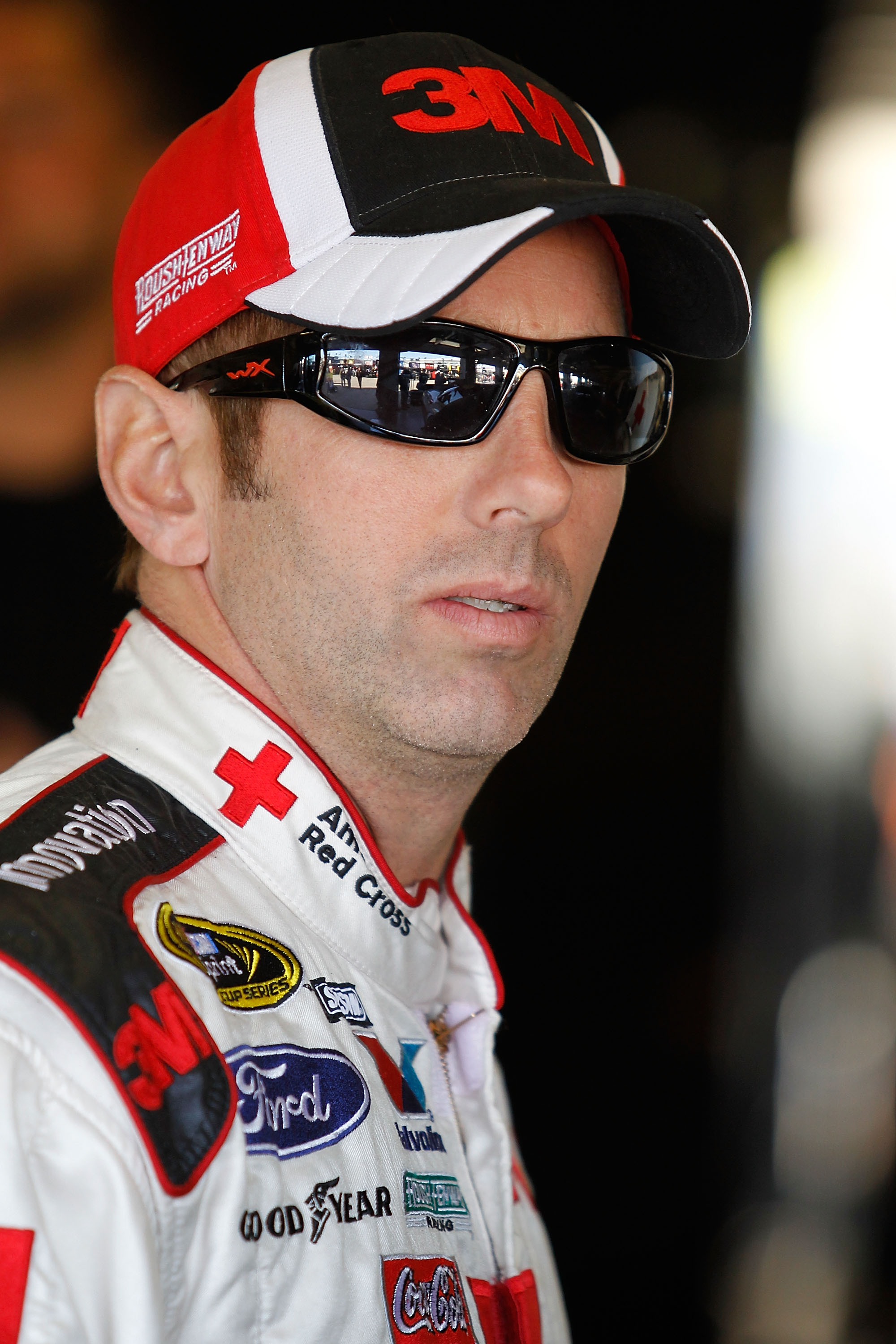 FORT WORTH, TX - NOVEMBER 06:  Greg Biffle, driver of the #16 American Red Cross Ford, stands in the garage area during practice for the NASCAR Sprint Cup Series AAA Texas 500 at Texas Motor Speedway on November 6, 2010 in Fort Worth, Texas.  (Photo by To