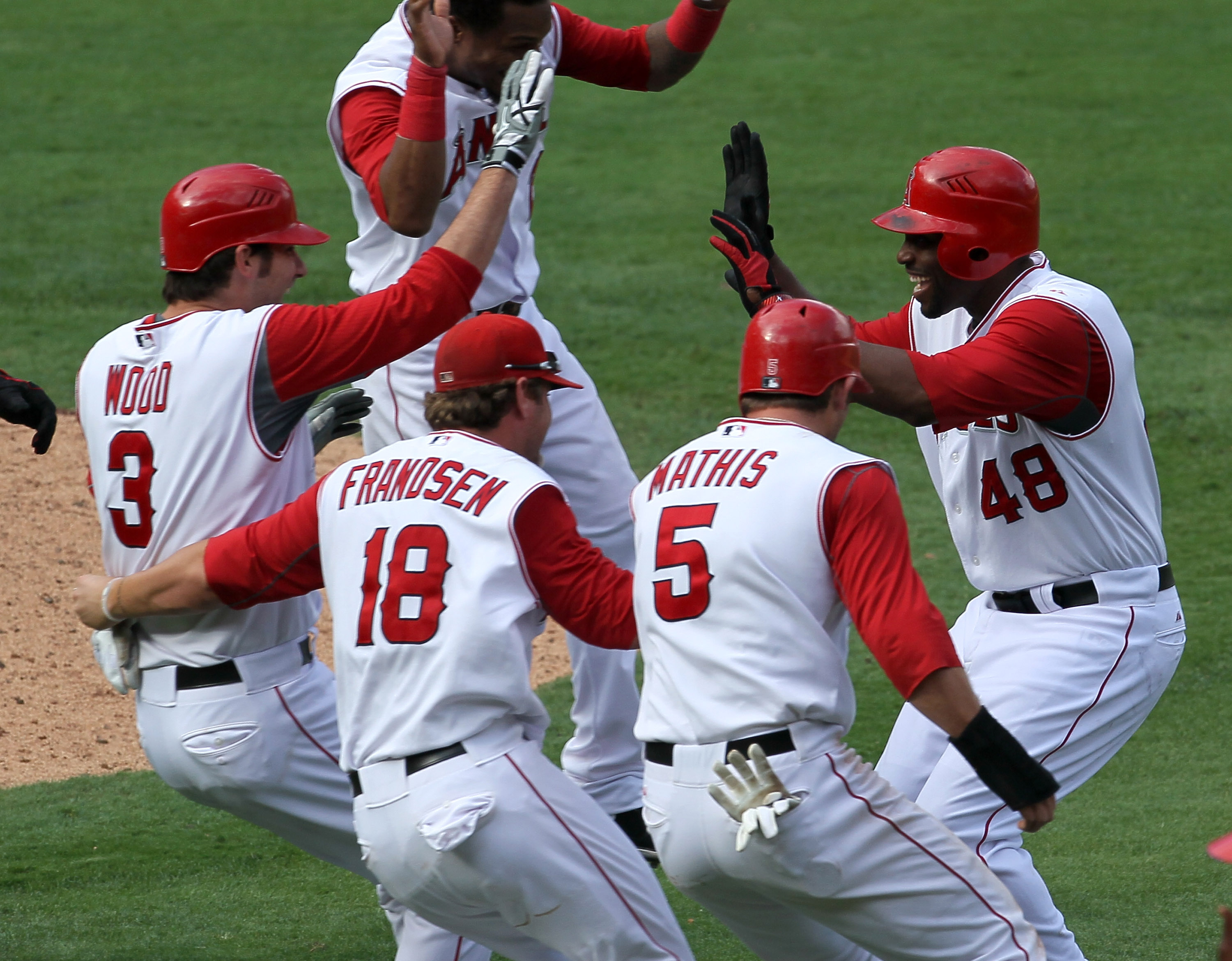 ANAHEIM, CA - SEPTEMBER 29:  Torii Hunter #48 of the Los Angeles Angels of Anaheim is mobbed by Brandon Wood #3, Kevin Frandsen #18, and Jeff Mathis #5 after Hunter's walk off single in the 11th inning ended the game with the Oakland Athletics on Septembe
