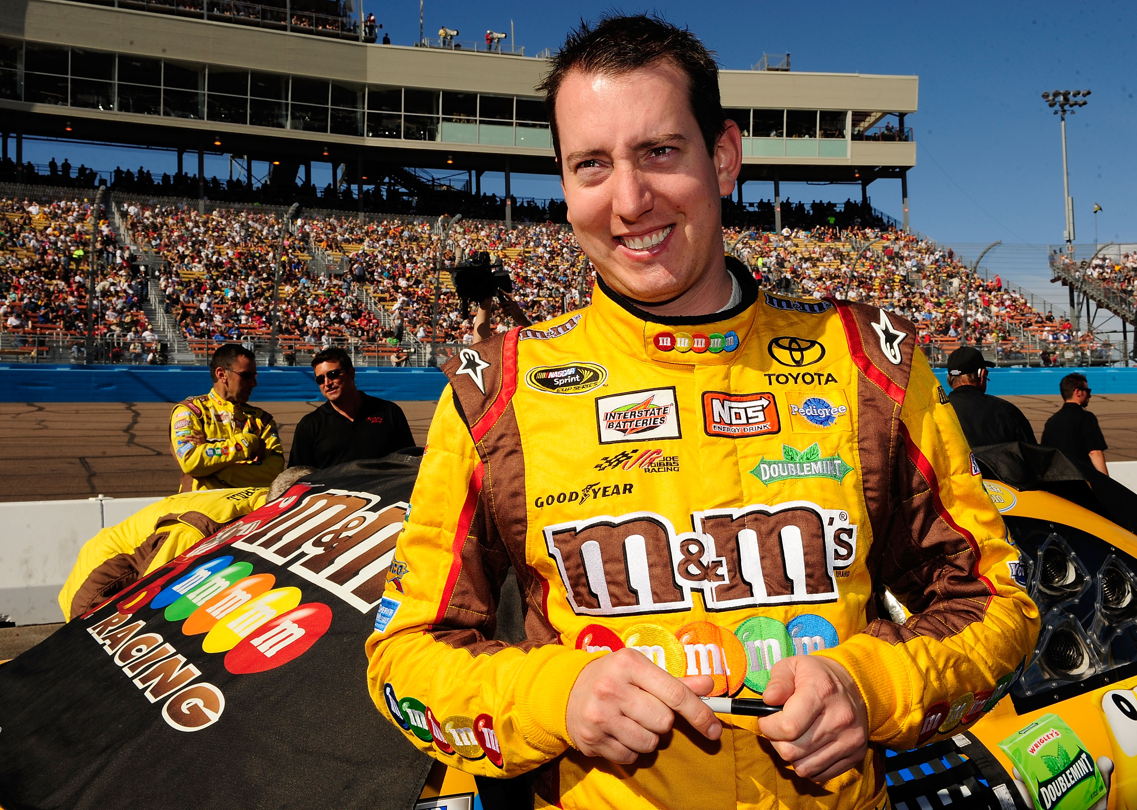 AVONDALE, AZ - NOVEMBER 14:  Kyle Busch, driver of the #18 M&M'sToyota, stands by his car prior to the NASCAR Sprint Cup Series Kobalt Tools 500 at Phoenix International Raceway on November 14, 2010 in Avondale, Arizona.  (Photo by Rusty Jarrett/Getty Ima
