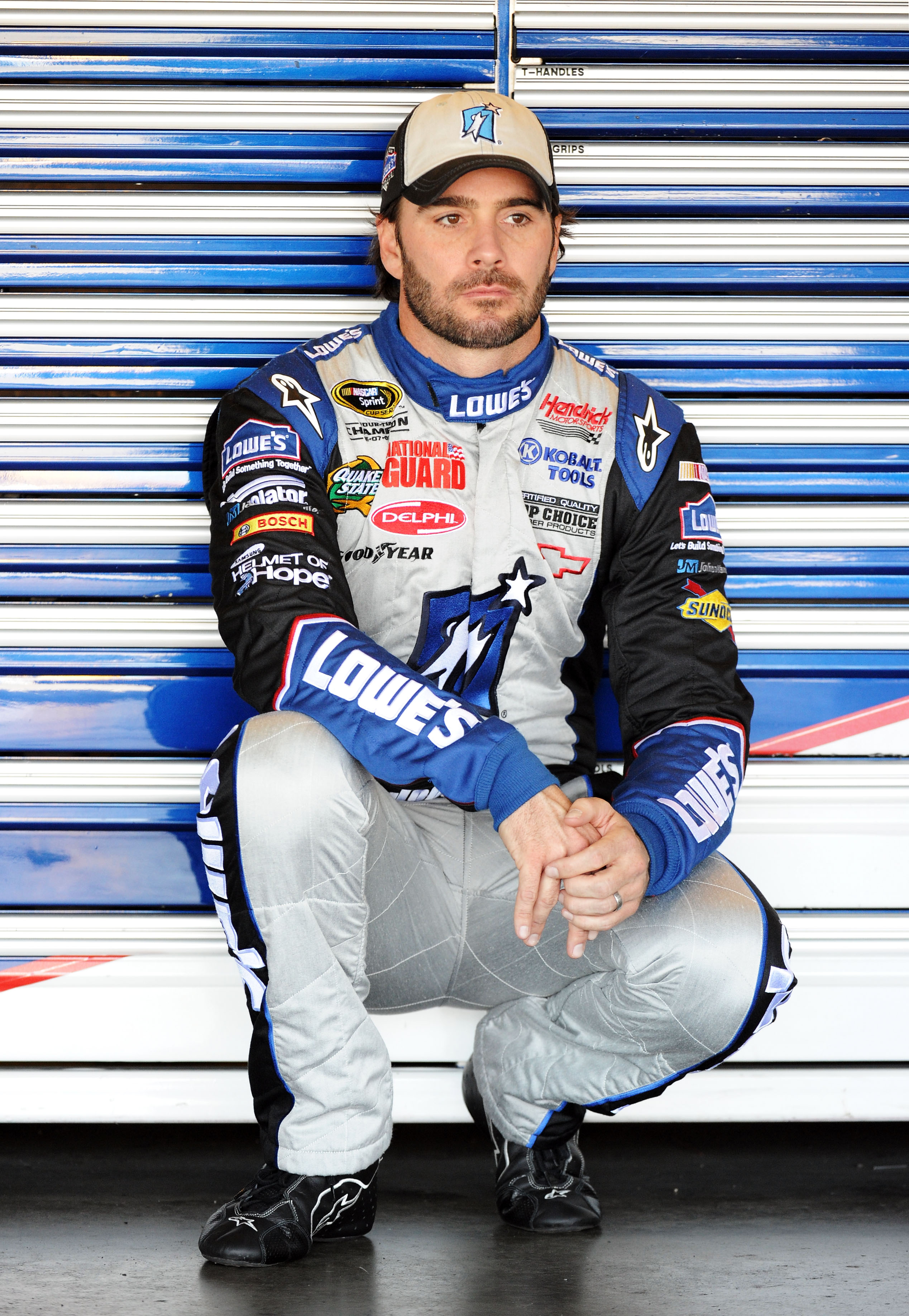 FONTANA, CA - OCTOBER 09:  Jimmie Johnson, driver of the #48 Lowe's/Jimmie Johnson Foundation Chevrolet, waits in the garage during practice for the NASCAR Sprint Cup Series Pepsi Max 400 on October 9, 2010 in Fontana, California.  (Photo by Harry How/Get