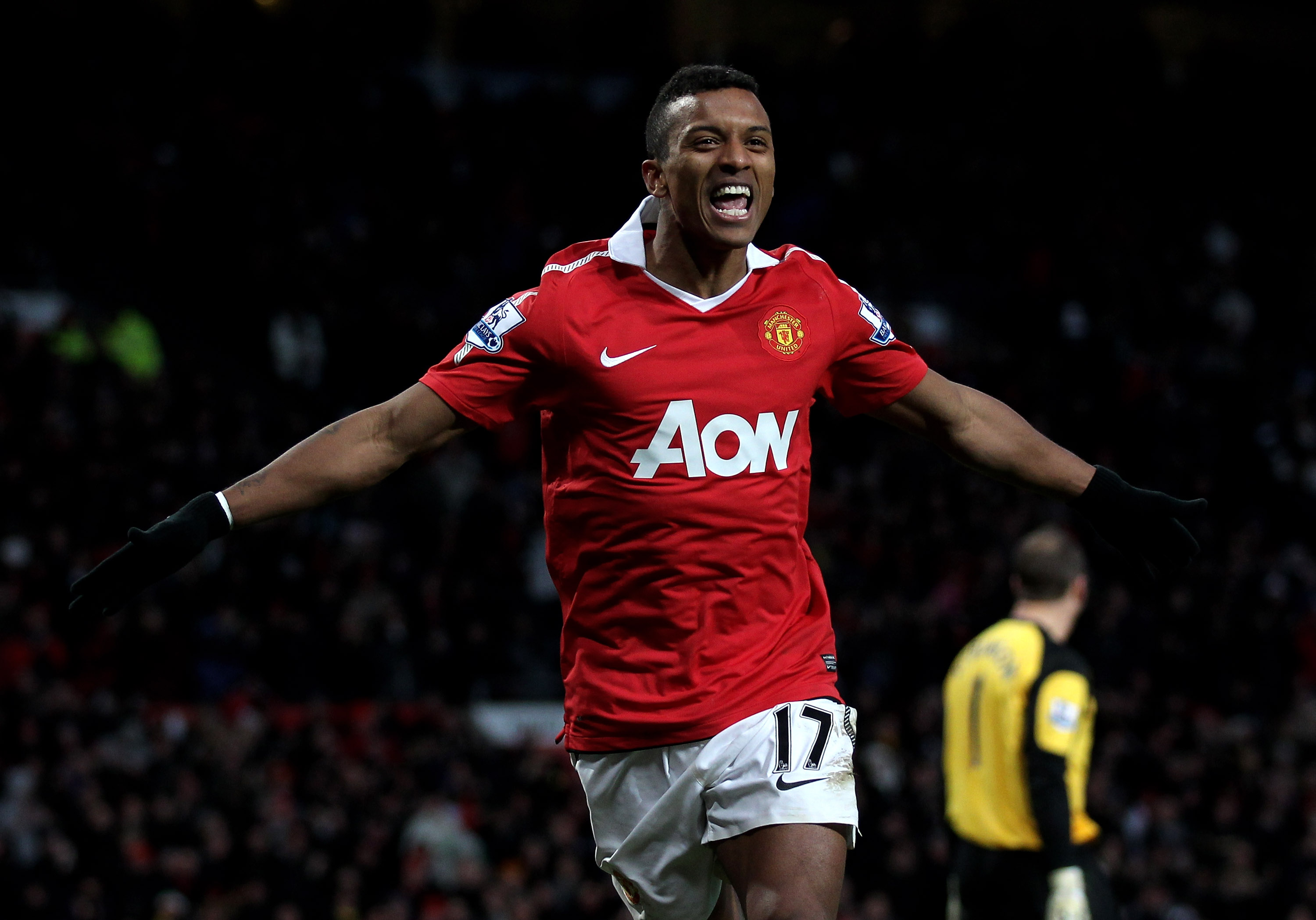 MANCHESTER, ENGLAND - NOVEMBER 27:  Nani of Manchester United celebrates scoring his team's fifth goal during the Barclays Premier League match between Manchester United and Blackburn Rovers at Old Trafford on November 27, 2010 in Manchester, England.  (P