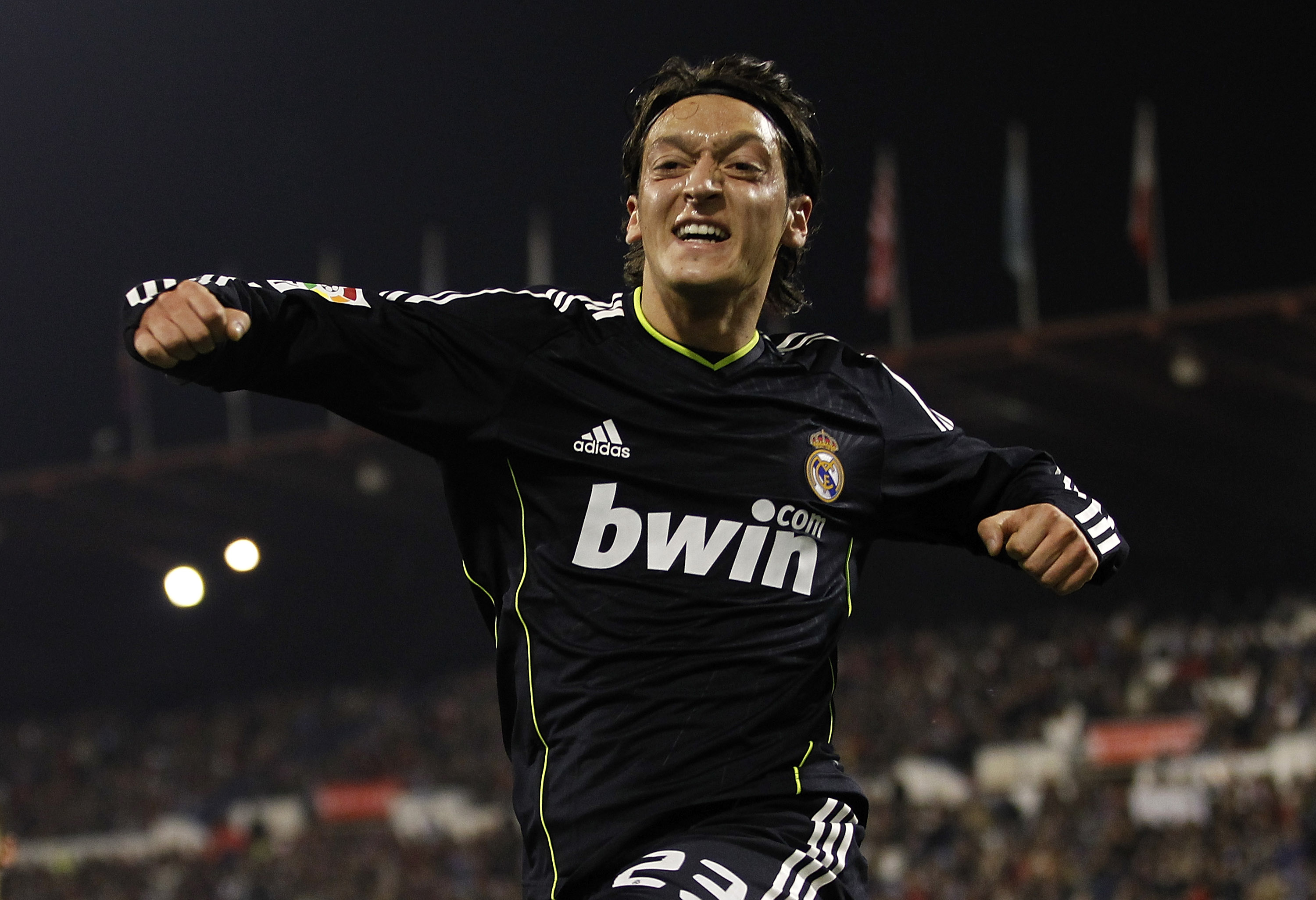 ZARAGOZA, SPAIN - DECEMBER 12: Mezut Ozil of Real Madrid celebrates after scoring Real's opening goal during the La Liga match between Real Zaragoza and Real Madrid at La Romareda stadium on December 12, 2010 in Zaragoza, Spain. (Photo by Angel Martinez/G
