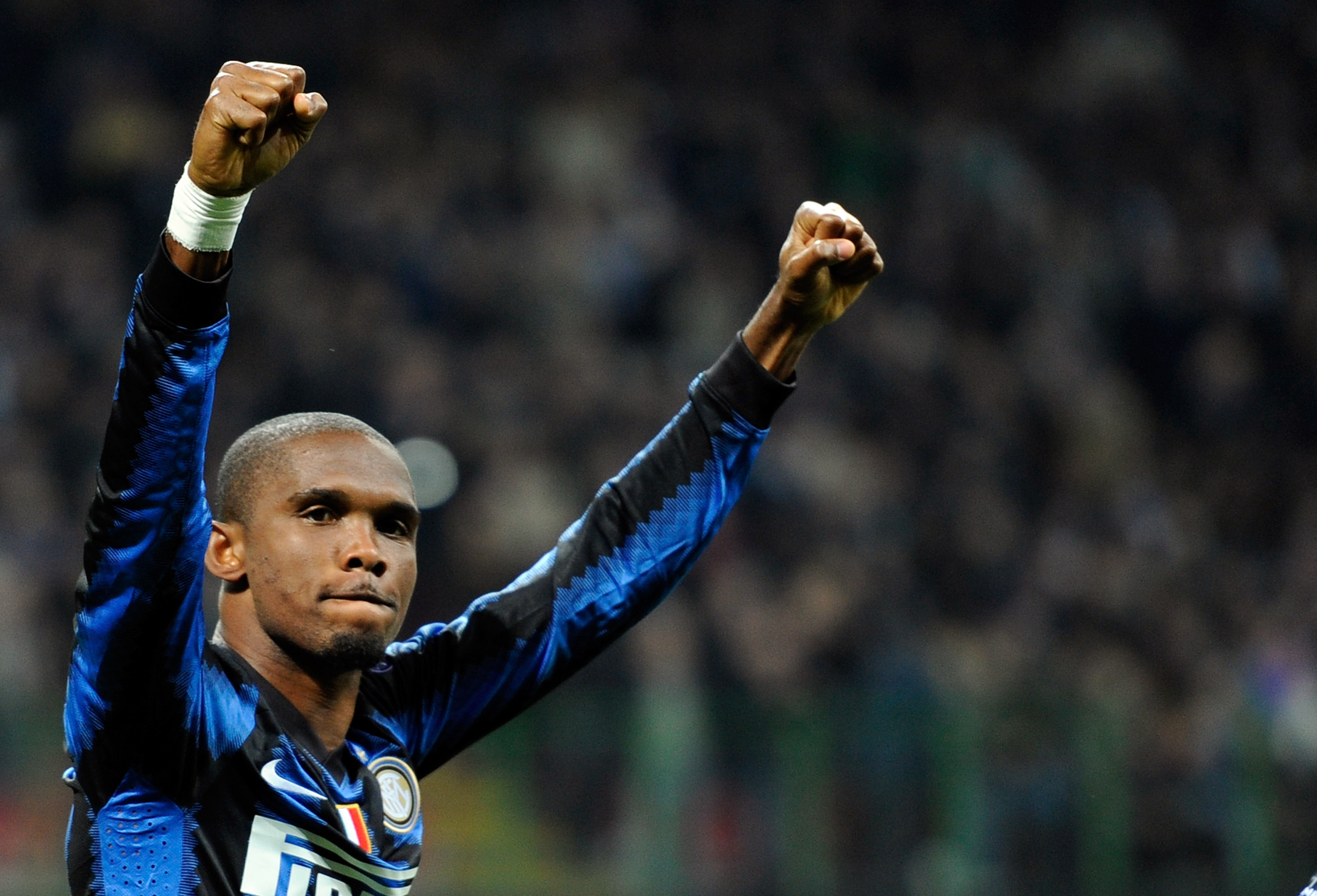 MILAN, ITALY - OCTOBER 20:   Samuel Eto'o of Inter Milan celebrates after the fourth goal during the UEFA Champions League group A match between FC Internazionale Milano and Tottenham Hotspur at Stadio Giuseppe Meazza on October 20, 2010 in Milan, Italy.